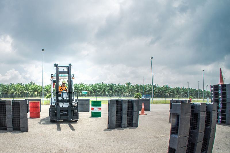 a group of technician are conducting tests to obtain a certificate of authorization to drive fork lift at the work area Airport Cloud - Sky Day Fork Lift Hyundai Industry Niosh No People Outdoors Sky Taking Photos Tranquility Tyre