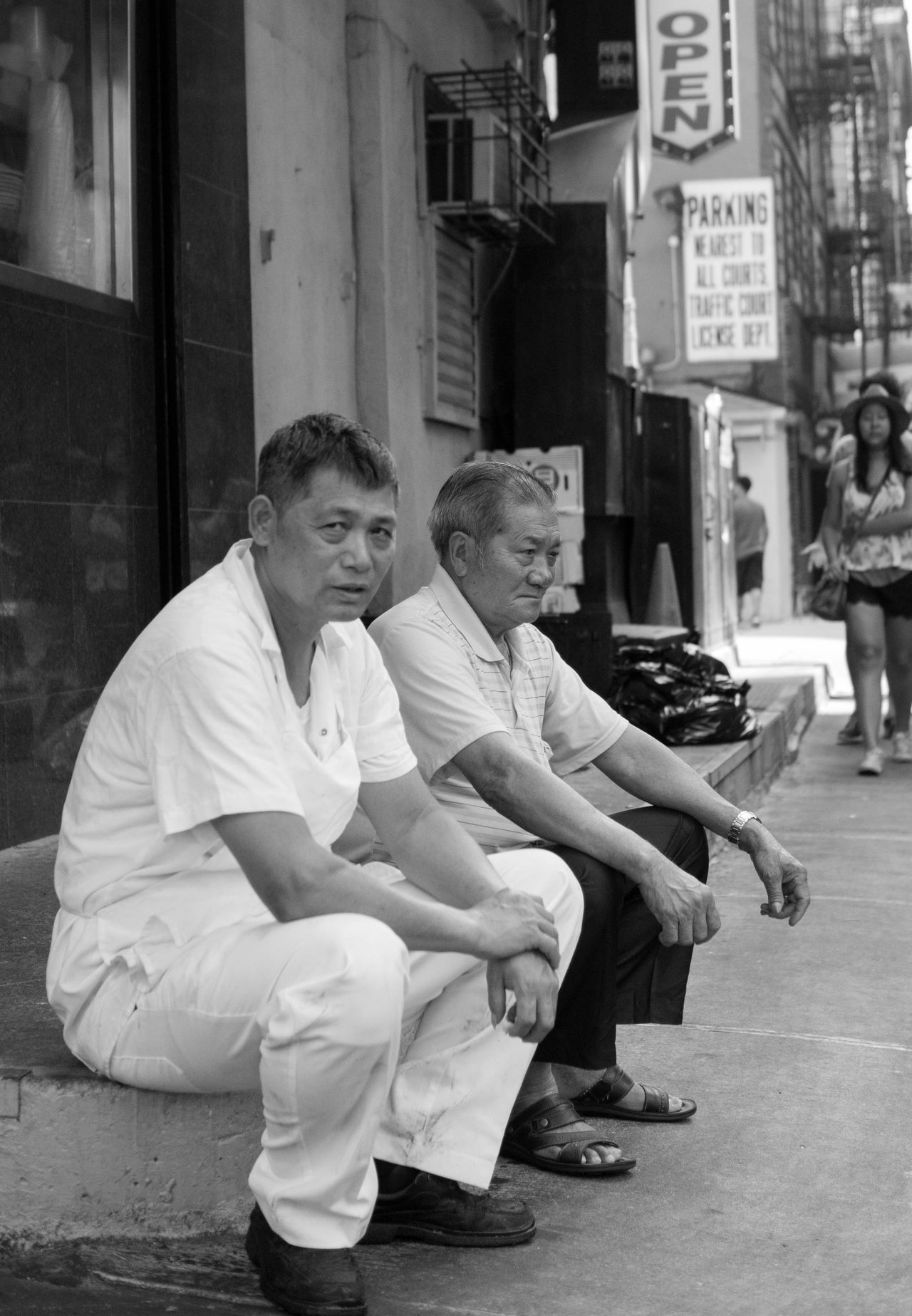 Chinatown, New York. A break from cooking. Black And White Chefs Chinatown New York Cigarette Time Leisure Activity Lifestyles Men New York Newyorkcity Occupation Real People Sitting Streetphotography First Eyeem Photo Showcase: December