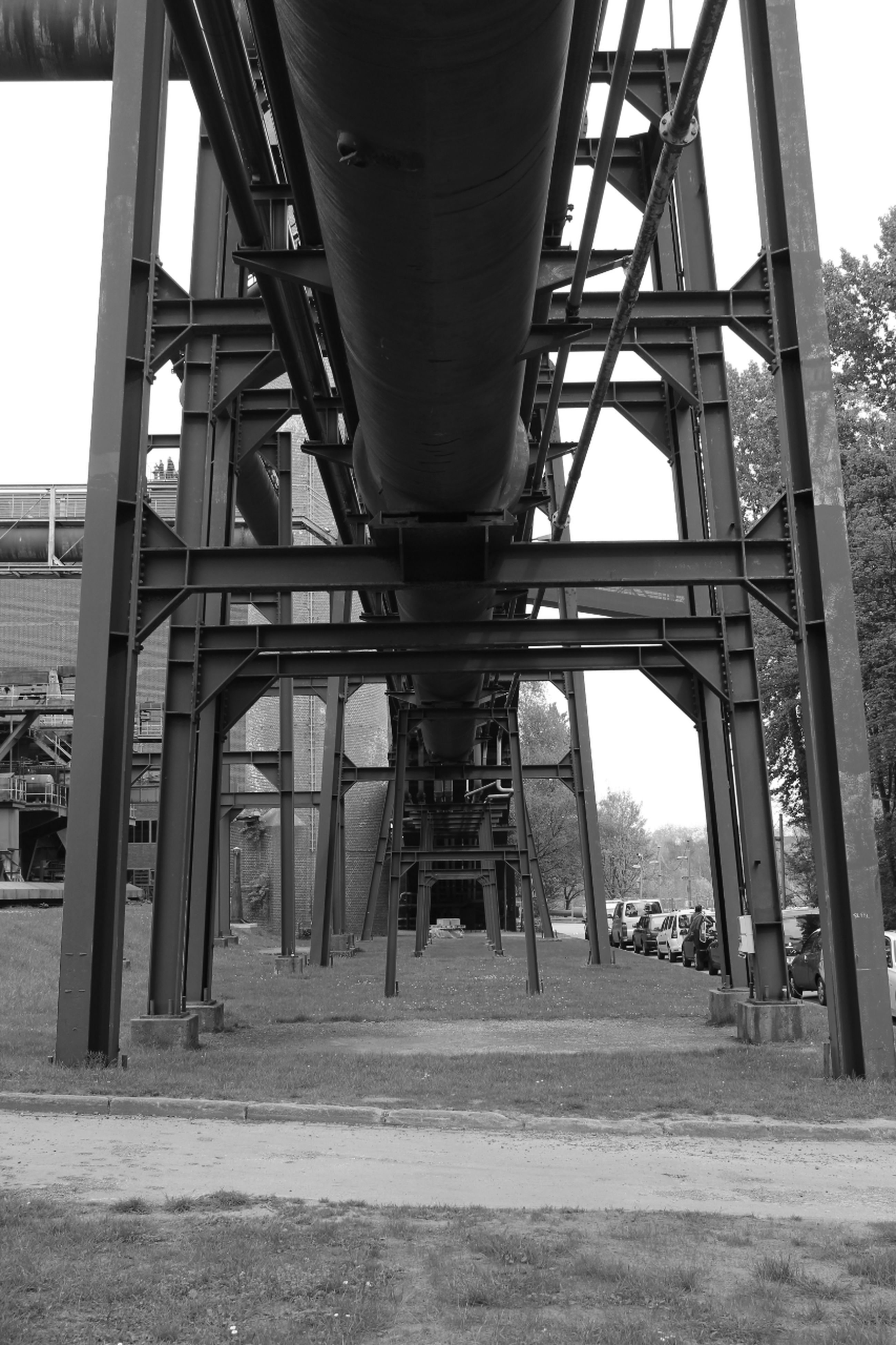 built structure, bridge - man made structure, architecture, connection, transportation, engineering, metal, sky, metallic, bridge, architectural column, day, low angle view, no people, outdoors, support, railway bridge, sunlight, river, below