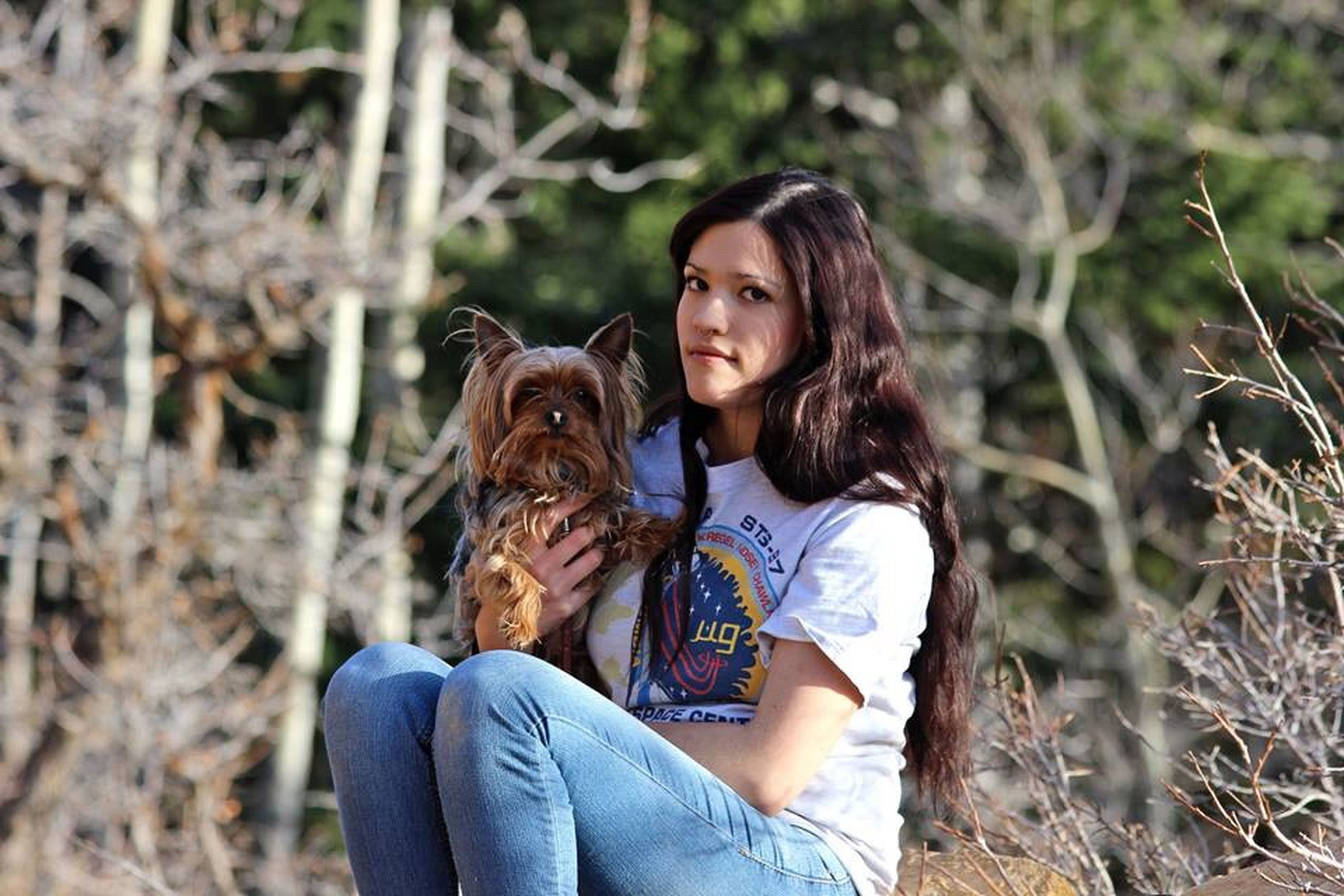 dog, pets, casual clothing, domestic animals, one animal, sitting, mammal, leisure activity, one person, real people, lifestyles, love, embracing, outdoors, bonding, young adult, friendship, young women, nature, day, women, smiling, portrait, adult, people, adults only