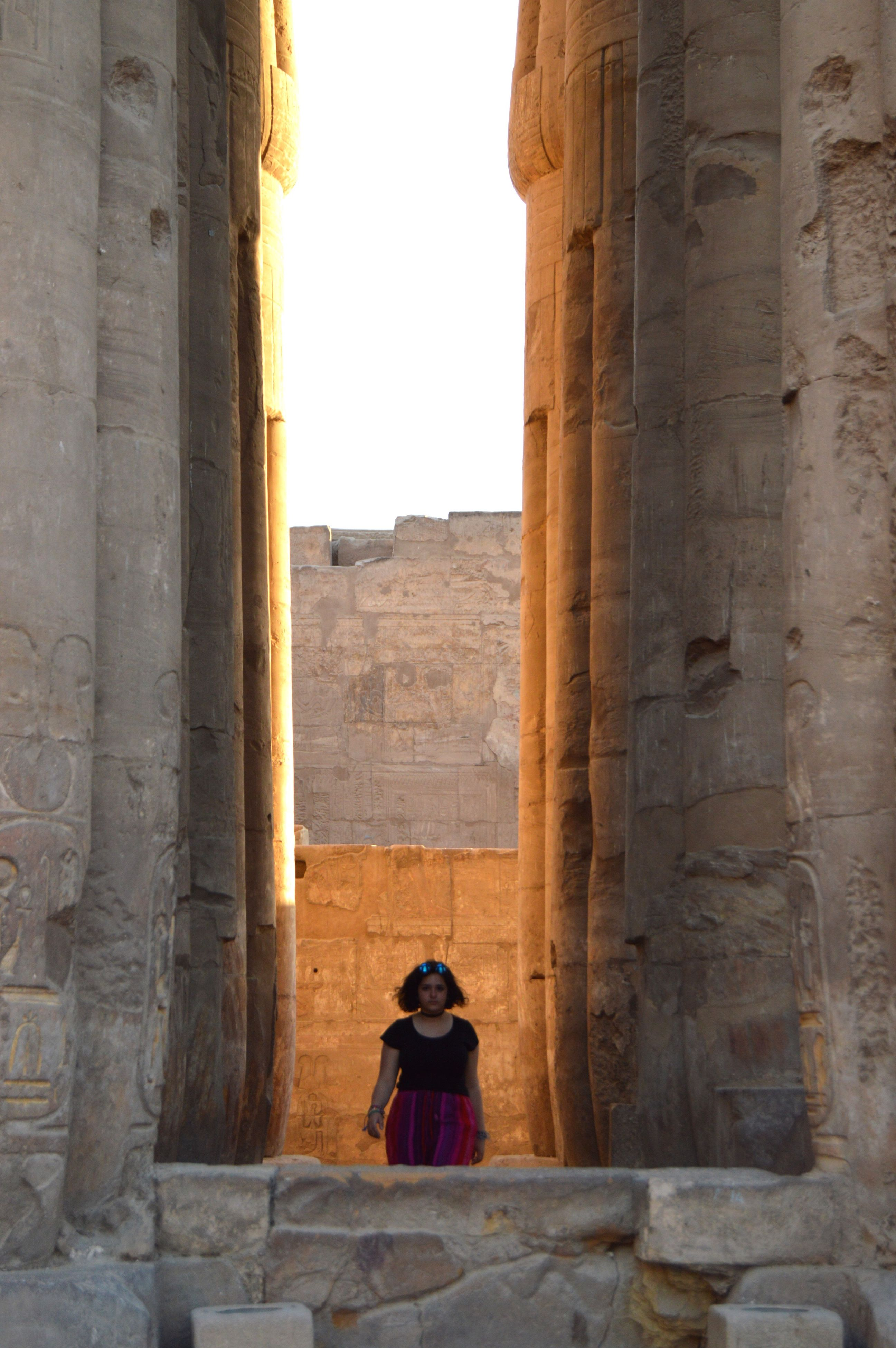 architecture, old ruin, built structure, real people, history, ancient, building exterior, architectural column, traditional clothing, lifestyles, arch, one person, tourism, women, travel destinations, religion, leisure activity, young women, day, outdoors, ancient civilization, place of worship, young adult, sky, adult, people
