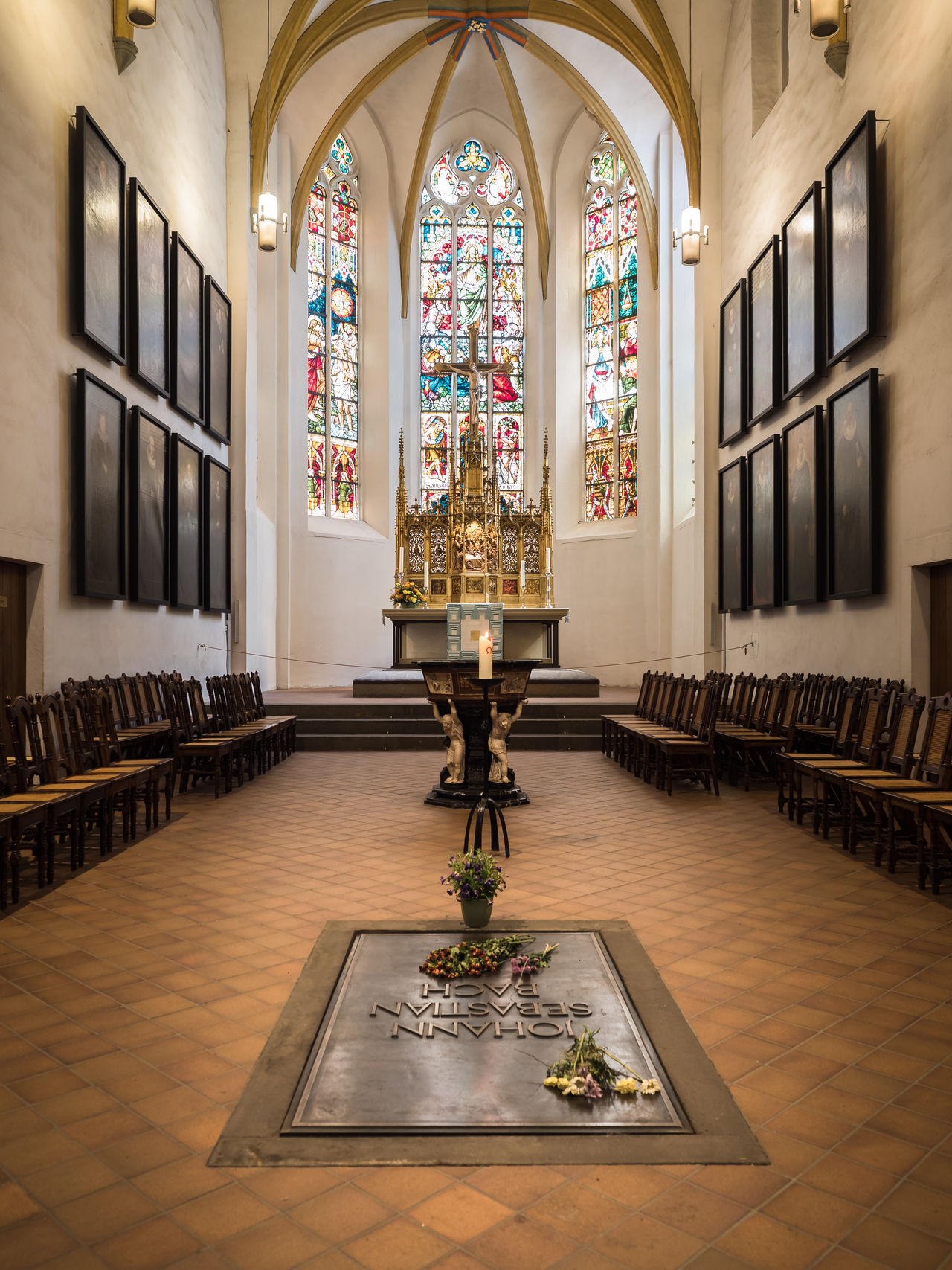 """This is the famous """"Thomaskirche"""" (church). You see here the grave of Johann Sebastian Bach. Altar Architecture Church Church Architecture Classical Music Composer Cross Culture Day Grave History Indoors  Johann Sebastian Bach Leipzig No People Place Of Worship Religion Spirituality Thomaskirche Window"""