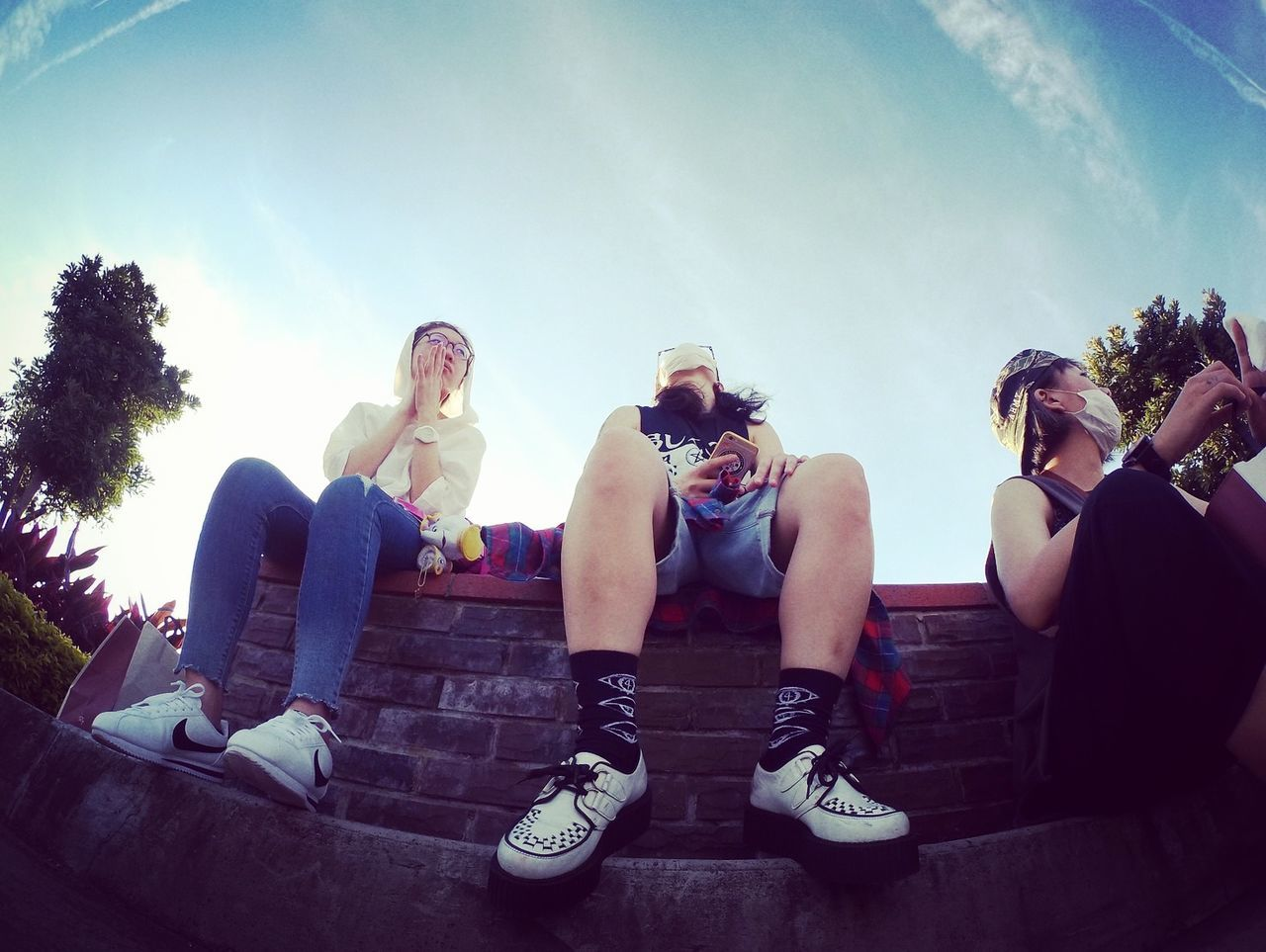 sitting, day, low angle view, shoe, men, outdoors, sky, togetherness, real people, friendship, tree, young adult, people