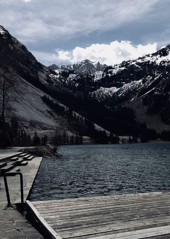 lake shore in the alps Hiking The Week On EyeEm Travel Adventure Alps Beauty In Nature Clouds Forest Jetty Lake Landscape Mountain Mountain Range Nature Outdoors Rural Scene Scenics Sky Snow Snowcapped Mountain Spring Tranquil Scene Tree Vilsalpsee Water