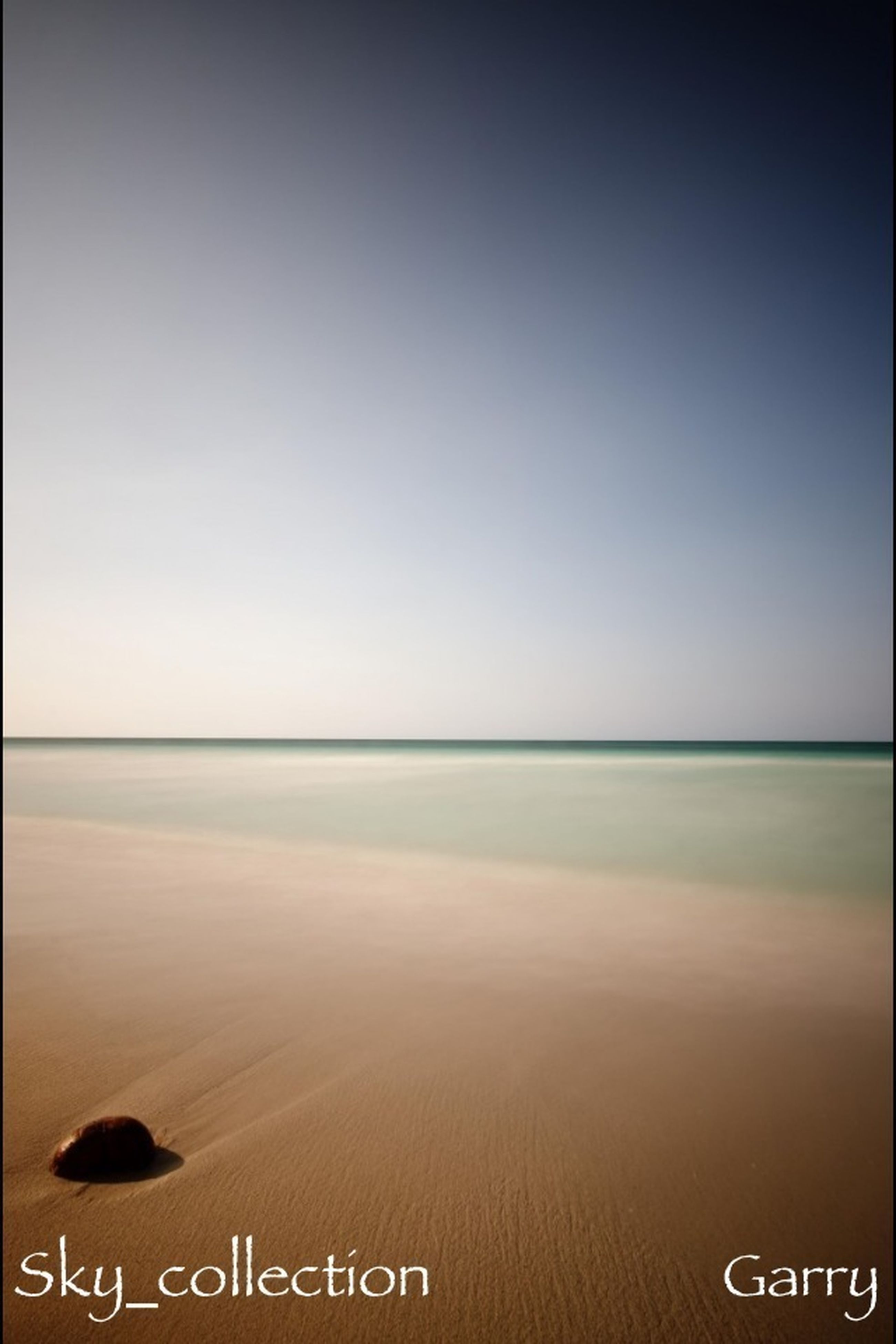 water, text, sea, western script, clear sky, communication, copy space, tranquil scene, horizon over water, tranquility, scenics, nature, beach, beauty in nature, shore, auto post production filter, outdoors, sign, no people, sky