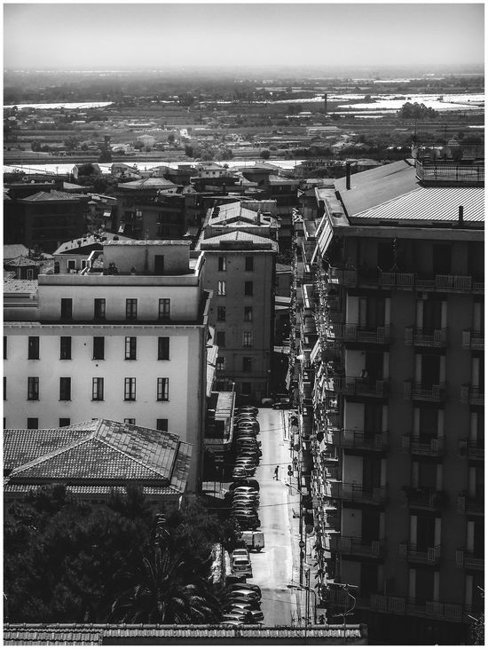 For more galleries www.costangelo.com About section for publications, links to them and contacts. COSTANGELOP-->FB/TWITTER/INSTAGRAM Blackandwhite Architecture Asphalt Beautiful Black And White Building Exterior Building Story Campania City City Life Cityscape Day Dramatic Angles Eboli Italia Italy Man Outdoors Powerful Provincia Di Salerno Residential Building Sky Small People Small Person Tall - High The Street Photographer - 2017 EyeEm Awards The Great Outdoors - 2017 EyeEm Awards The Photojournalist - 2017 EyeEm Awards The Architect - 2017 EyeEm Awards