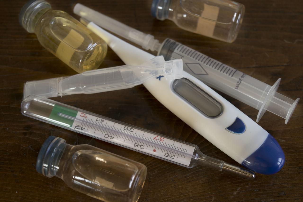 flu vaccine in bottle forseasonal illness Drug Flu Illness Influenza Medical Medicine Meningitis Phial Prevention Research Syringe Test Tube Therapy Thermometer Vaccine Vaccines
