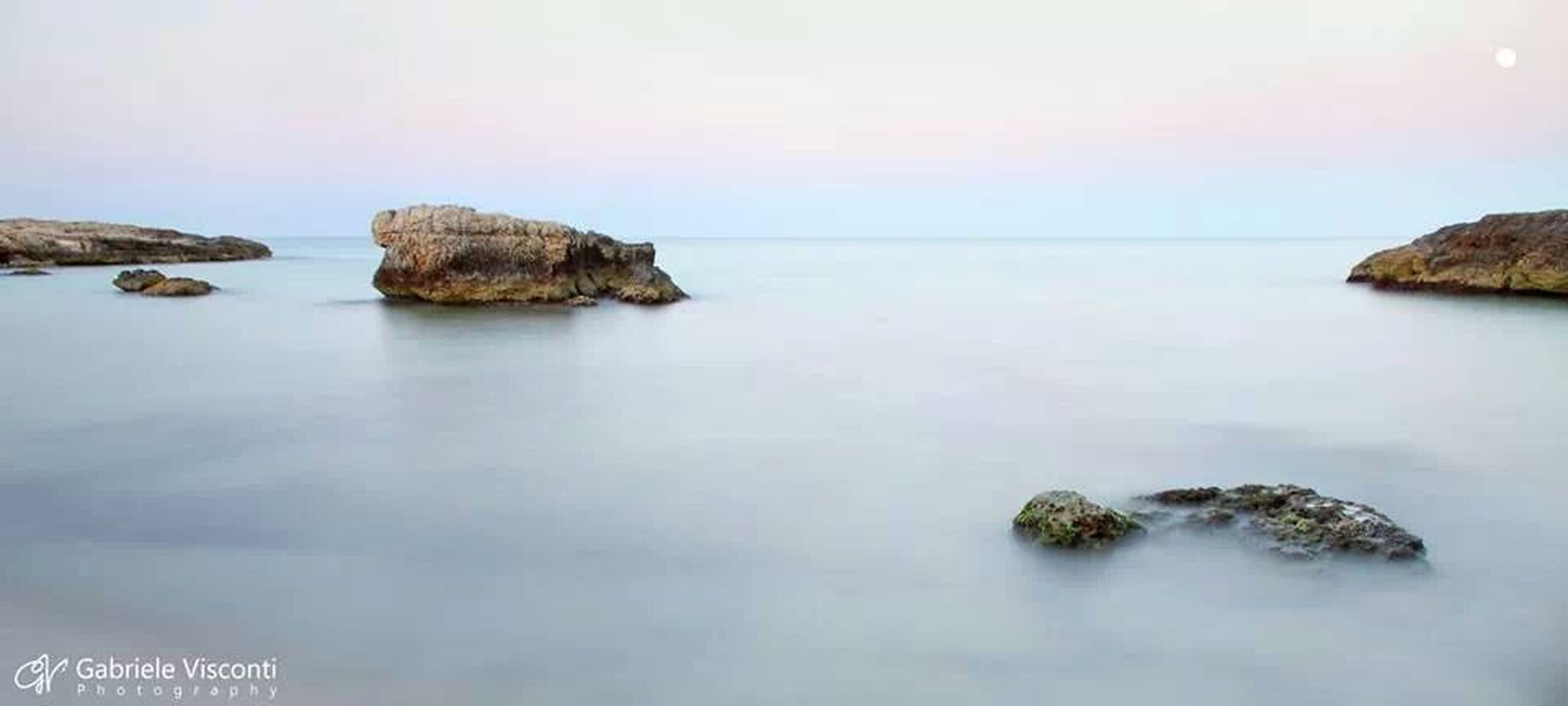 water, sea, tranquil scene, tranquility, scenics, horizon over water, beauty in nature, rock - object, nature, rock formation, sky, waterfront, idyllic, rock, reflection, calm, clear sky, no people, outdoors, non-urban scene