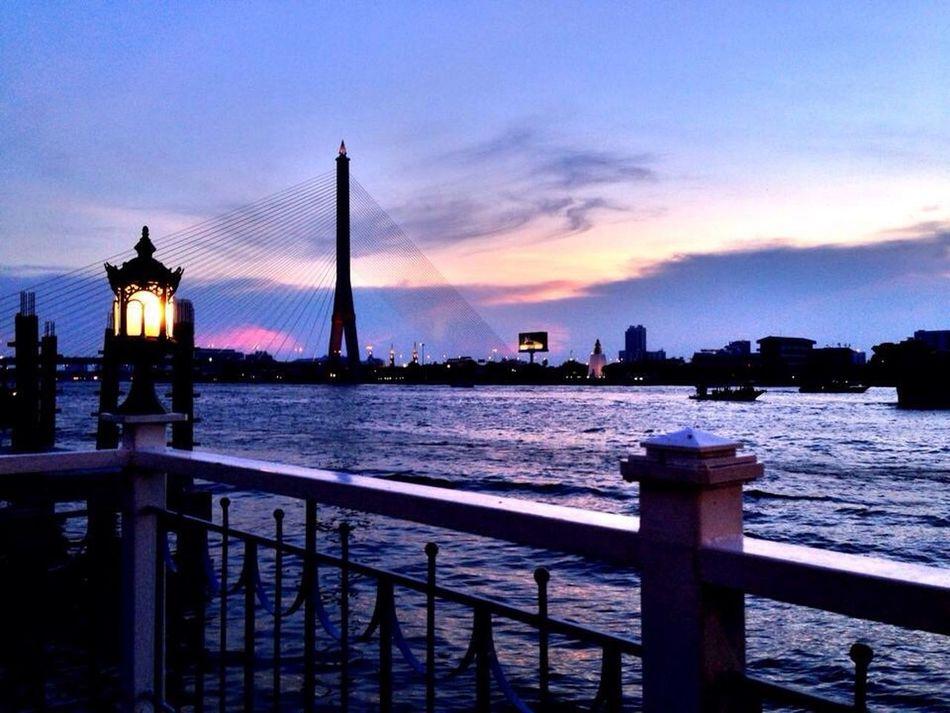 The sun is going down Vll Bridge Bangkok Thailand