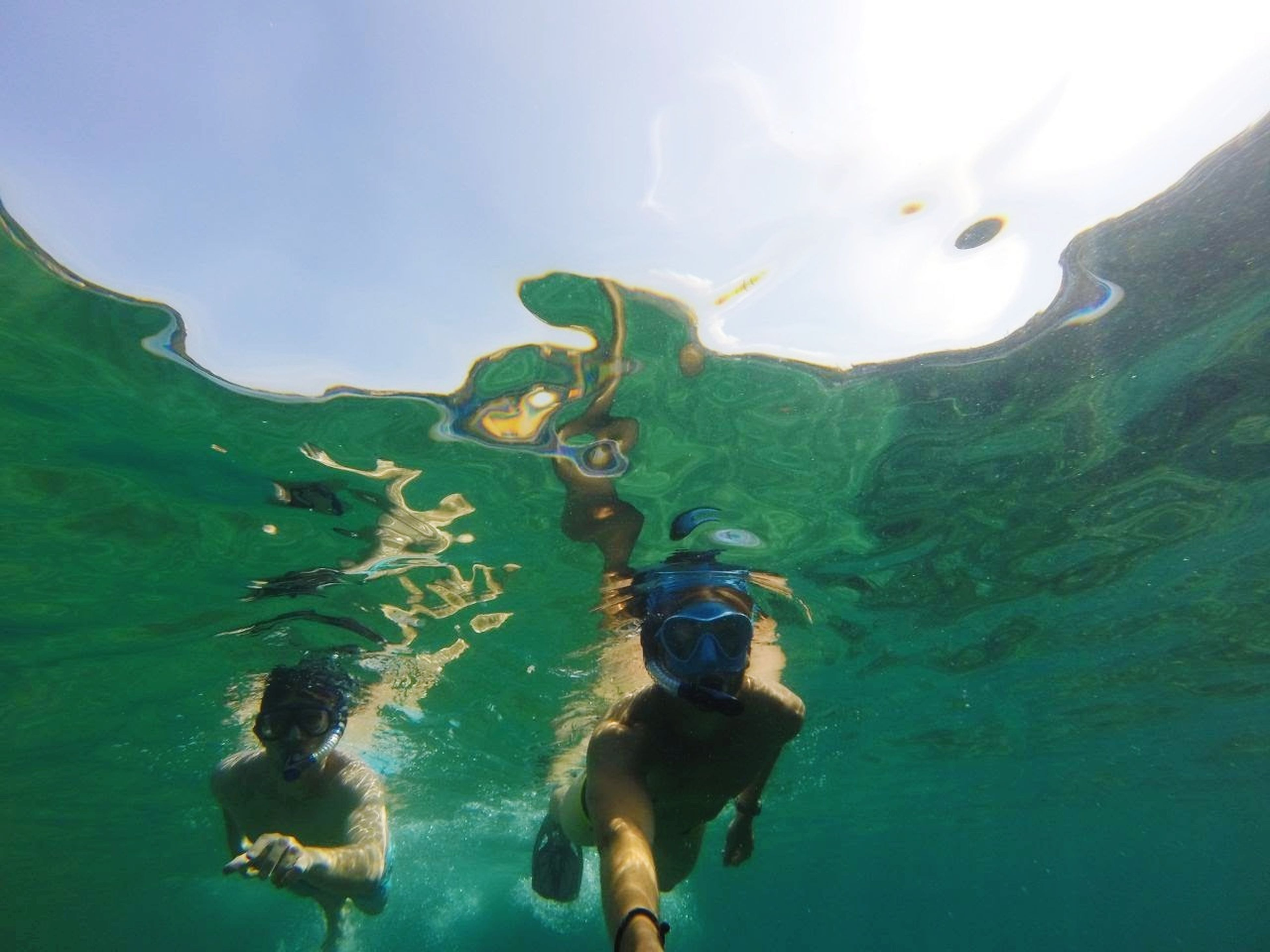 swimming, adventure, water, sea, day, leisure activity, underwater, snorkeling, nature, real people, undersea, outdoors, full length, beauty in nature, one person, scuba diving, sky, young adult, people