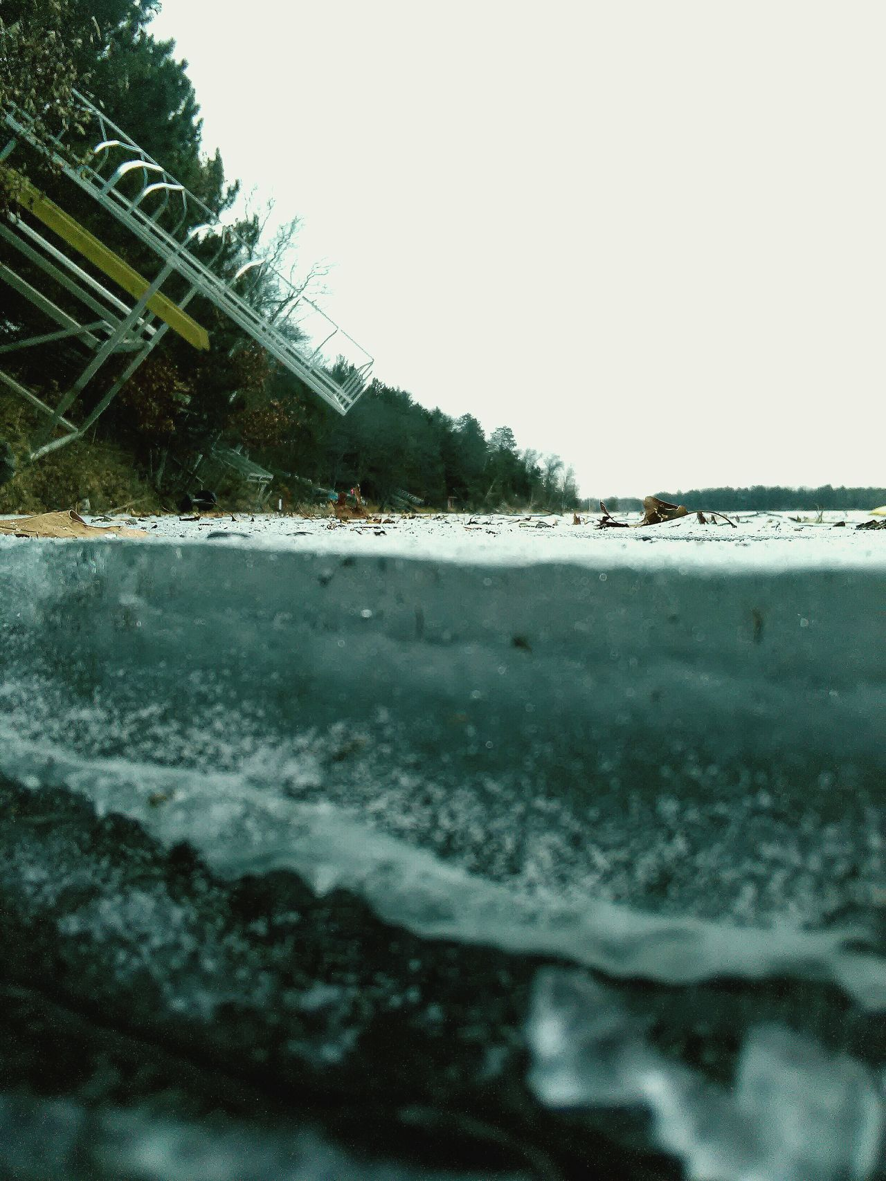 Lets get crackin' on this spring thaw! No People Outdoors Nature Day Frozen Lake Thawing Cracks Ice Steep Hill Resting Pontoon Spring Anticipation Sky EyeEm New Here