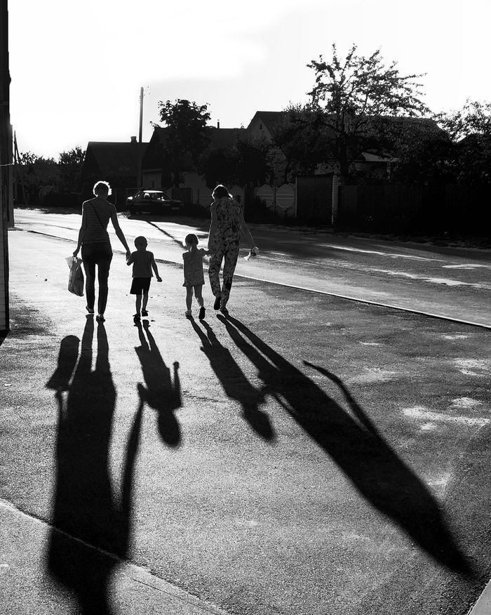 Fatherhood Moments Shadow Sunlight Architecture Built Structure Building Exterior Playing Tree Full Length Lifestyles Leisure Activity Street Sunny Walking Boys Togetherness Sport Enjoyment City Street Day Outdoors