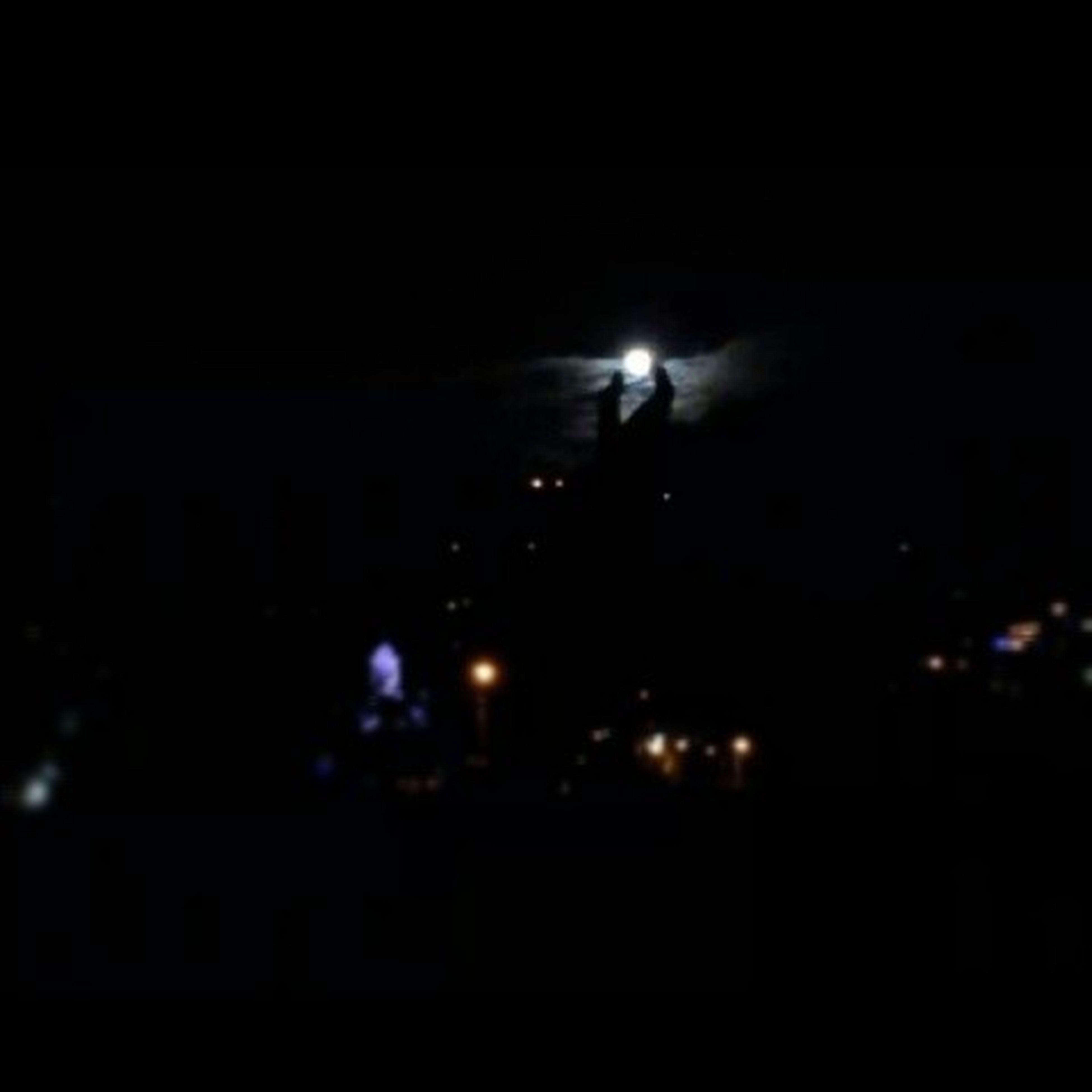 night, illuminated, dark, lighting equipment, light - natural phenomenon, copy space, glowing, defocused, light, sky, indoors, moon, silhouette, no people, low angle view, darkroom, street light, lit, black background