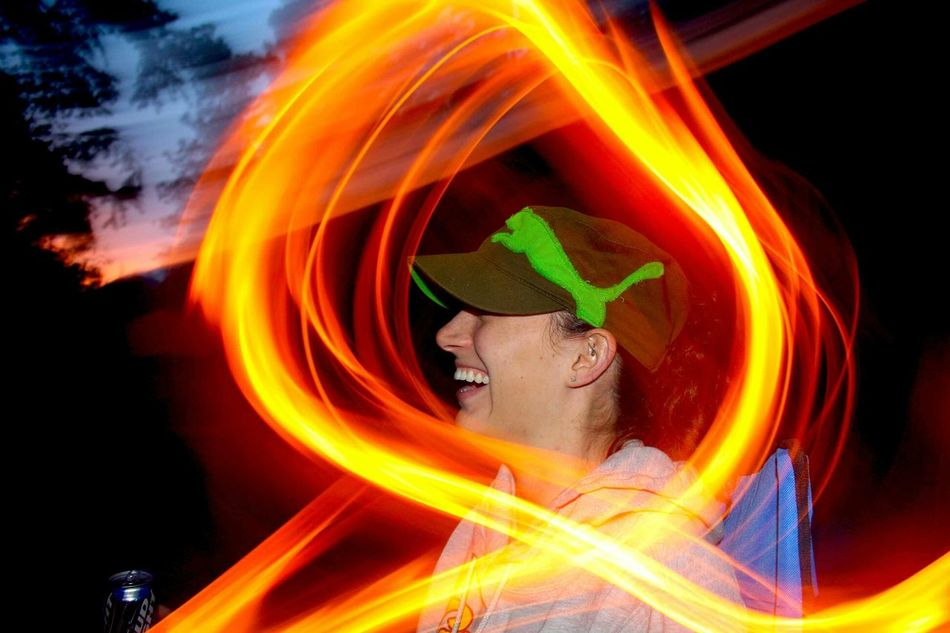 Feel The JourneyPhotography In Motion Motion Streaking Light Circle Movement Smile Smiling Night Lights Beauty Woman Flash Photography Laughing Happiness Light Up Your Life Portrait Of A Woman Face Camping Outdoors Showing Imperfection Human Meets Technology Telling Stories Differently