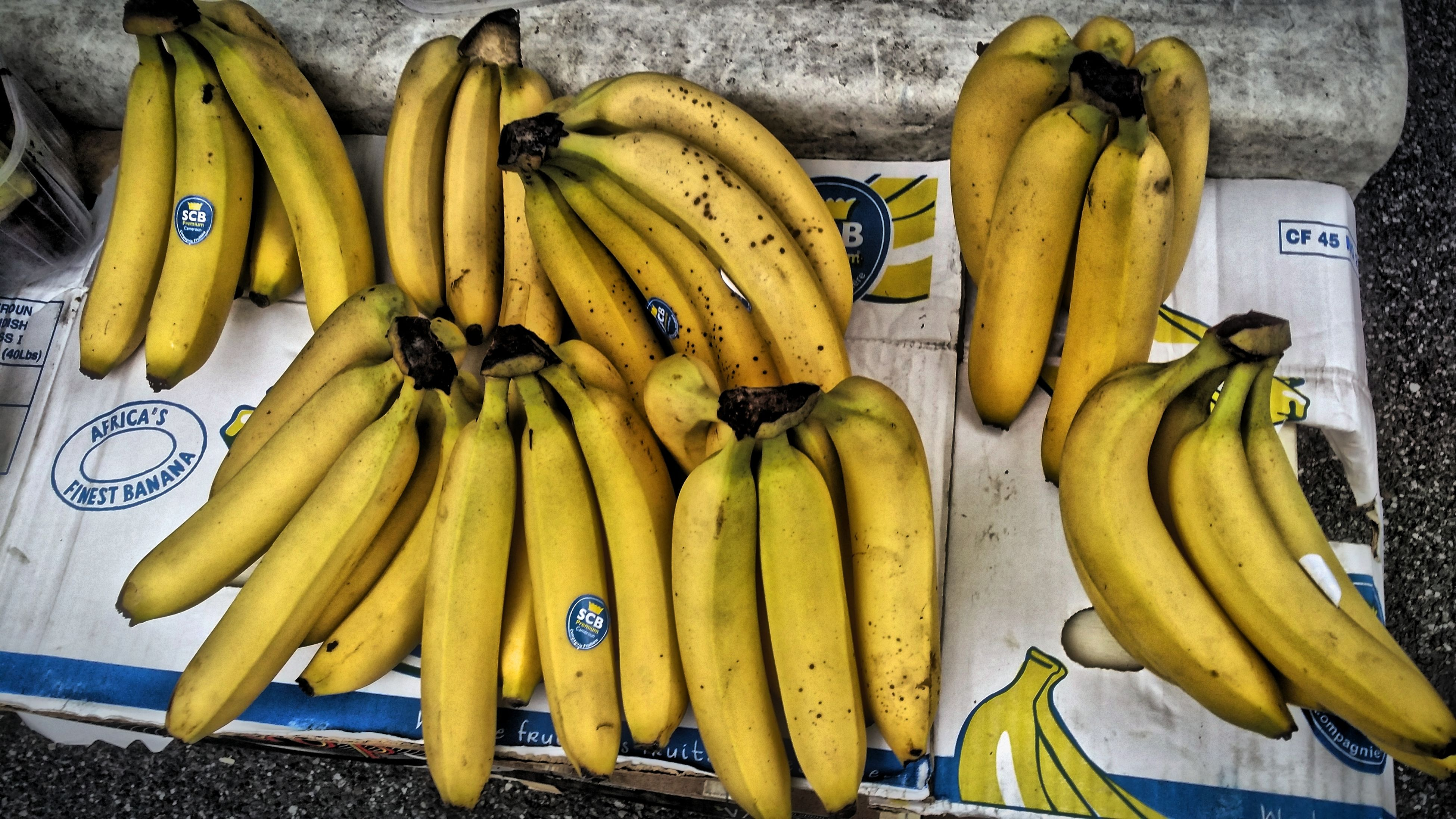 food and drink, food, healthy eating, freshness, yellow, high angle view, still life, vegetable, indoors, banana, variation, fruit, large group of objects, for sale, market stall, retail, raw food, choice, directly above, table