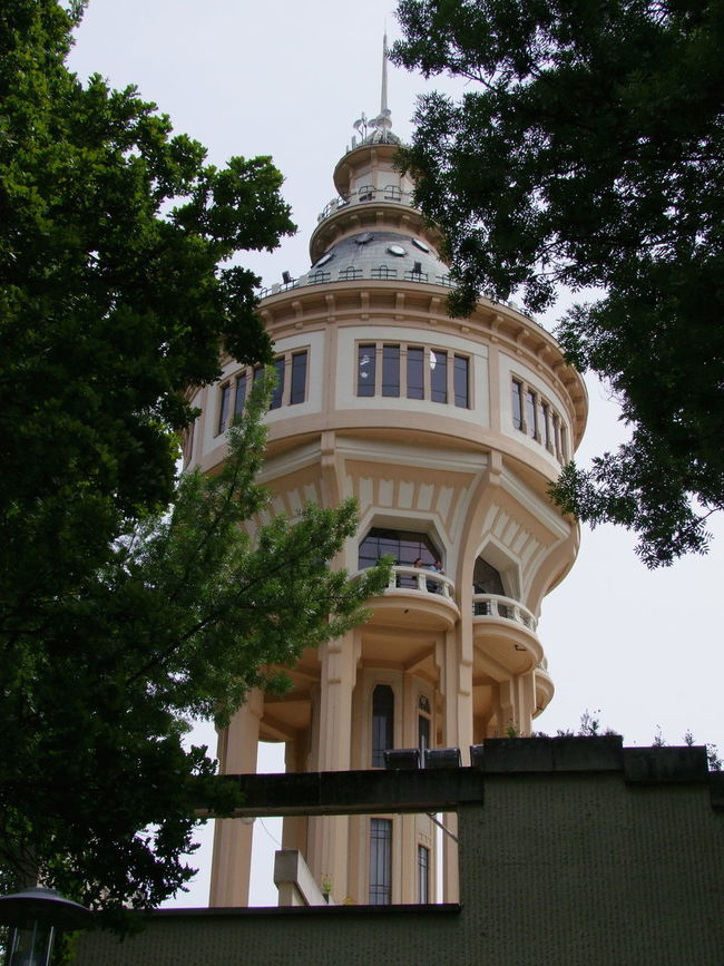 Water Tower (187 ft, built 1922), Margaret Island Architecture Budapest Building Exterior Built Structure Capital City Cloudy Sky Composition Cream Colour Full Frame High Hungary Low Angle View Margaret Island No People Outdoor Photography Round Building Tall Tourist Attraction  Tower Travel Destination Trees View Through The Trees Water Storage Water Tower