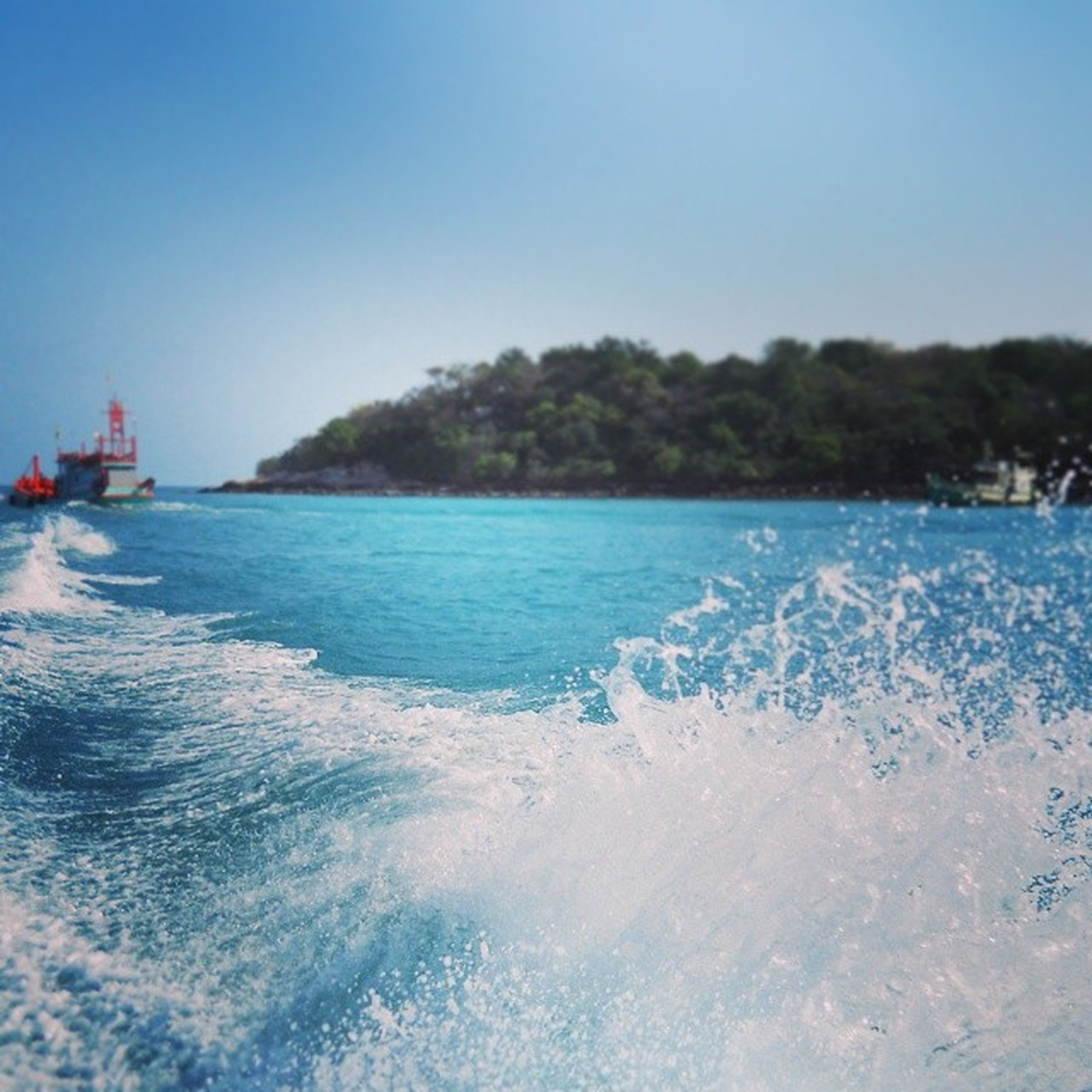 water, clear sky, sea, blue, copy space, waterfront, beauty in nature, scenics, wave, nature, surf, motion, tranquil scene, tranquility, beach, rippled, day, horizon over water, outdoors, nautical vessel
