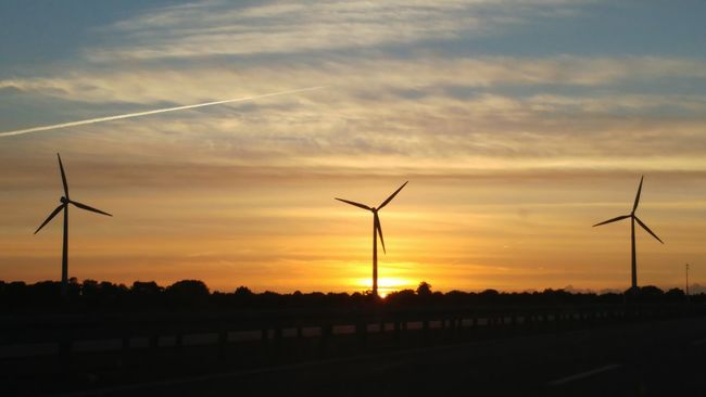 Same Renewable Energy Fuel And Power Generation Wind Turbine Wind Power Environmental Conservation Sunset Alternative Energy Windmill Silhouette Tranquil Scene Environment Scenics Landscape Tranquility Sun Rural Scene Beauty In Nature Majestic Orange Color Sky