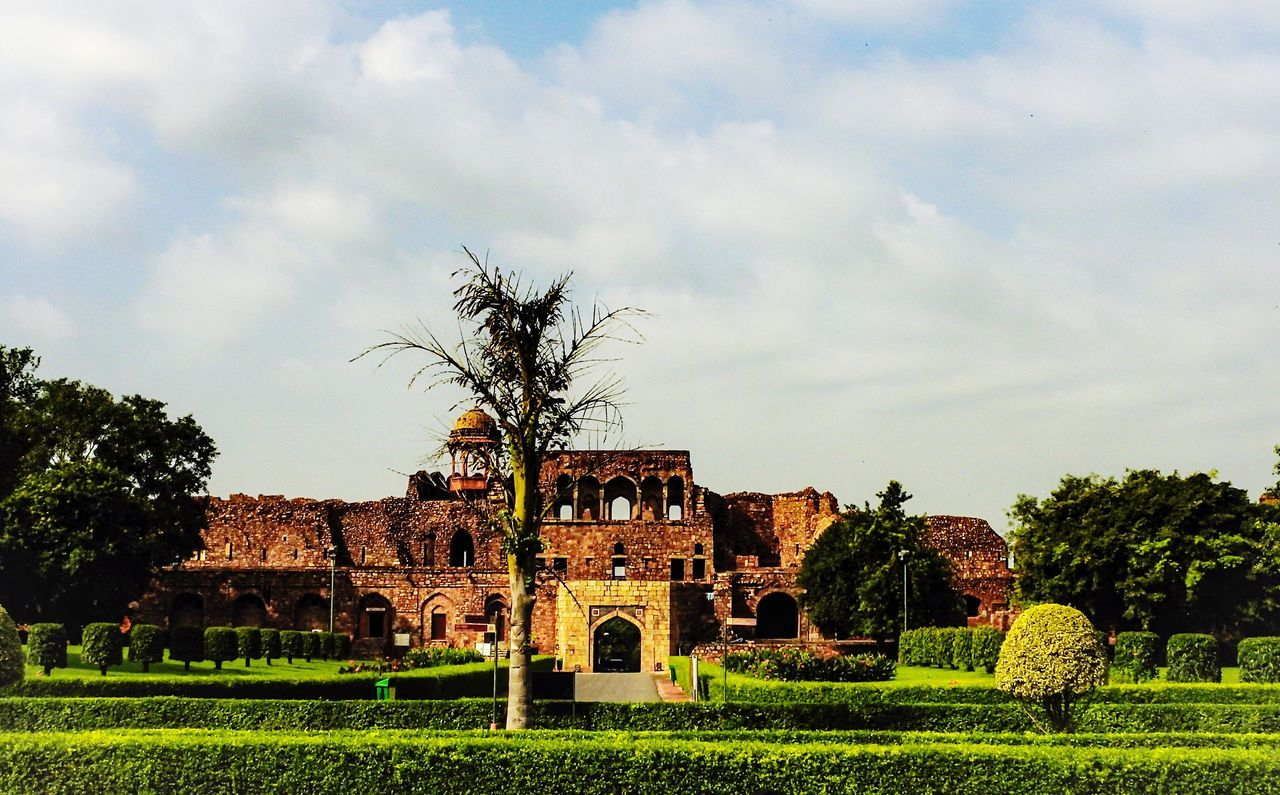architecture, built structure, tree, history, day, sky, building exterior, no people, grass, cloud - sky, outdoors, green color, old ruin, nature, growth, ancient, travel destinations, ancient civilization, beauty in nature