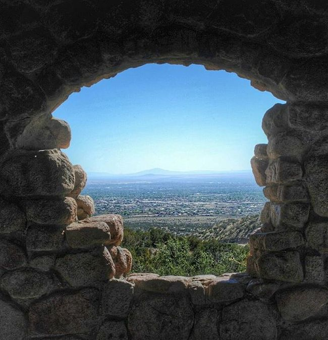A view of Albuquerque from inside a rock house in the Sandia Mountains. Processed with Snapseed Landscape Photography DSLR Nikon D700 SandiaMountains Newmexico NewMexicoTRUE Nmlife