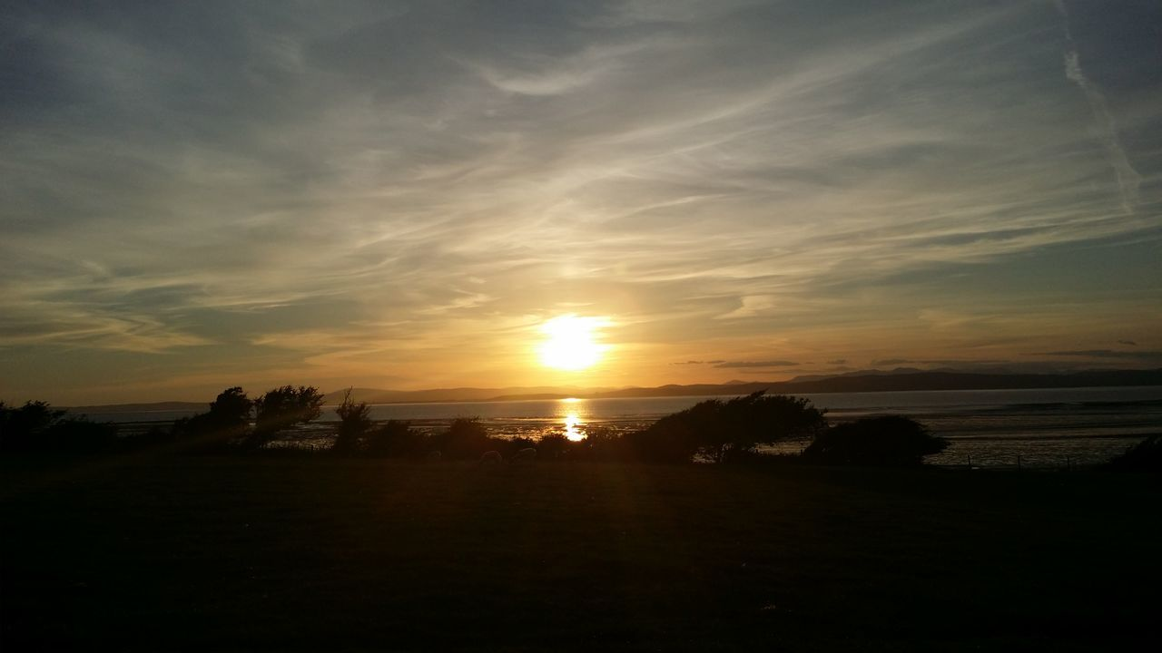 Morcombe Bay Siloutte Sunset Uk