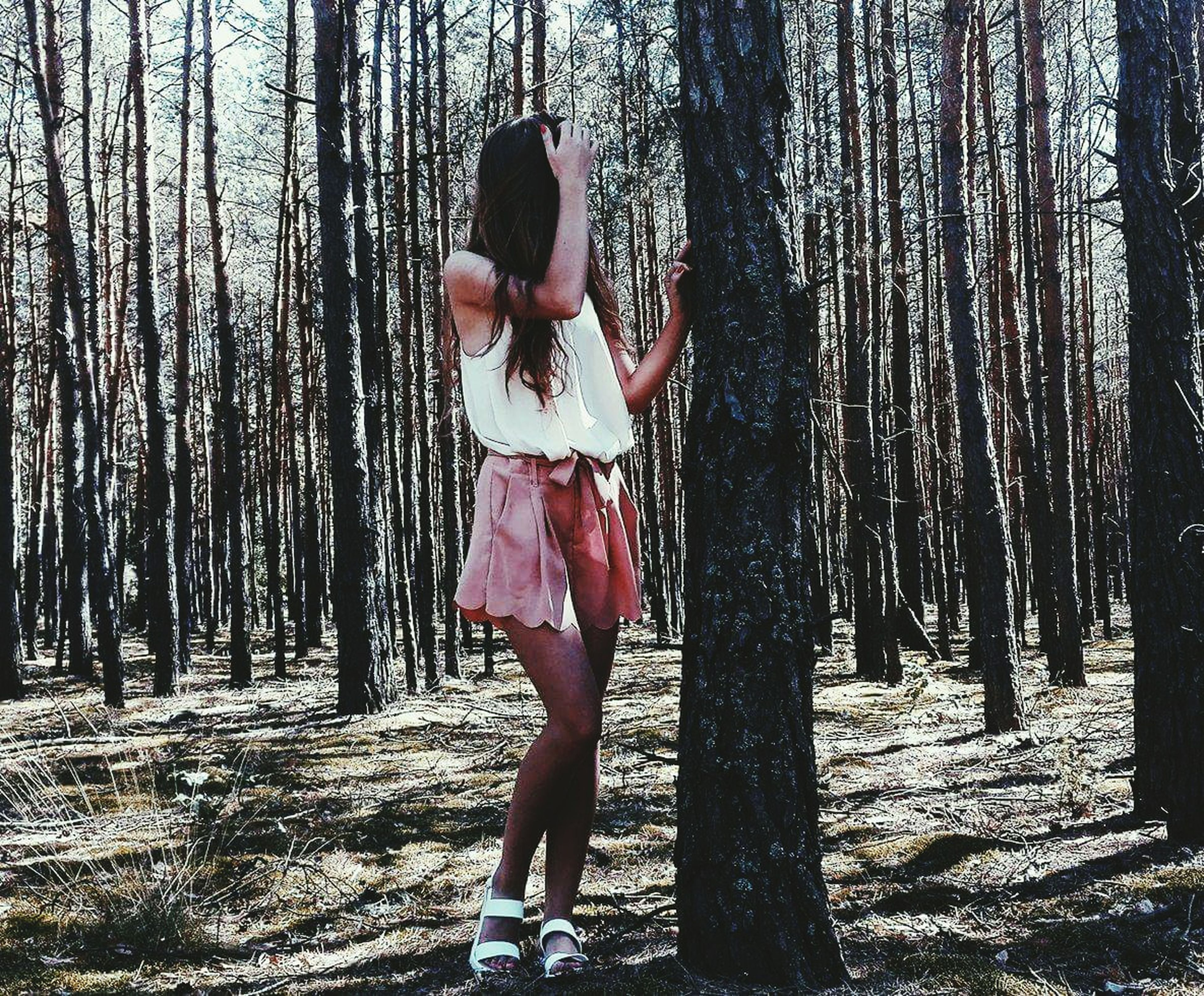 tree, lifestyles, leisure activity, tree trunk, forest, full length, casual clothing, woodland, nature, outdoors, day, tranquility, growth, tranquil scene, non-urban scene