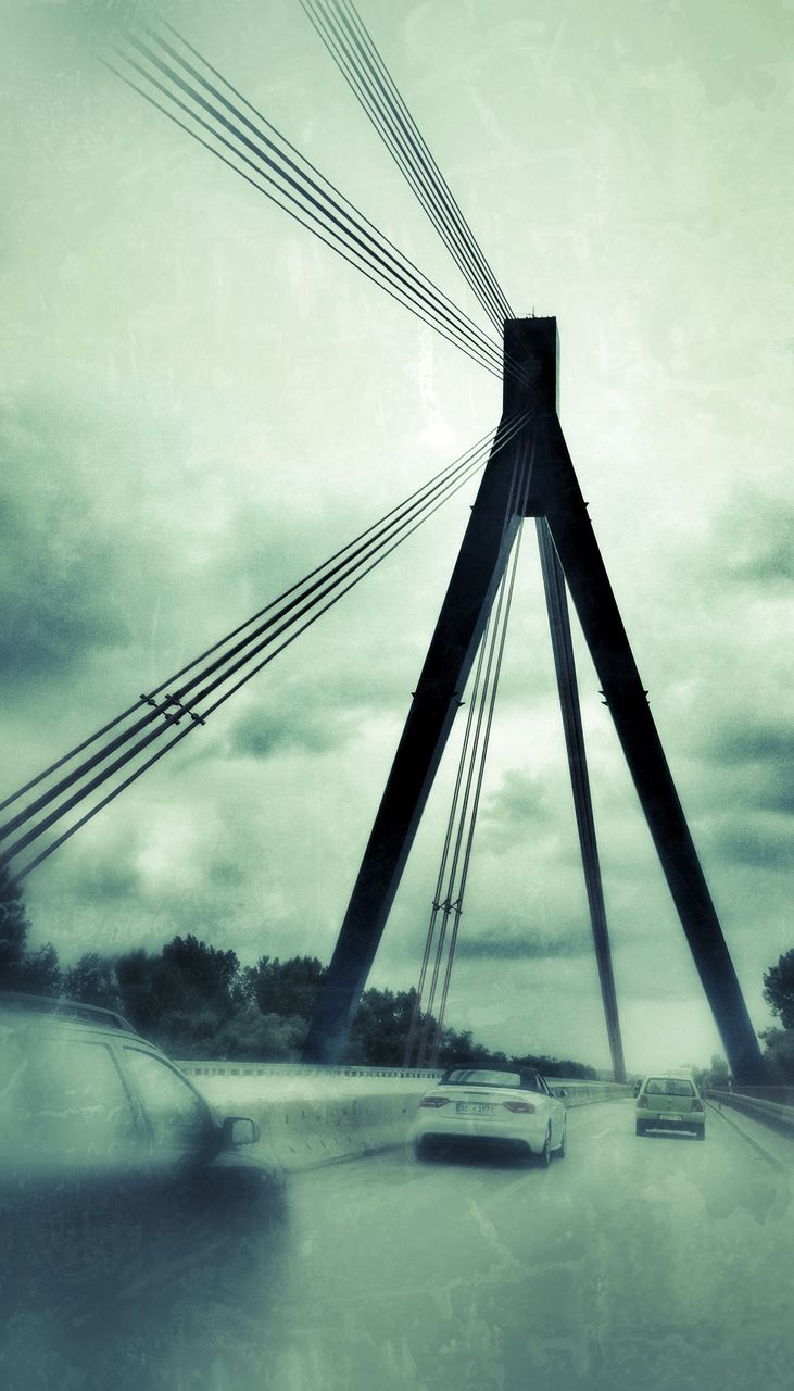 sky, connection, transportation, outdoors, cloud - sky, no people, low angle view, bridge - man made structure, day, suspension bridge, built structure, water, architecture, nature