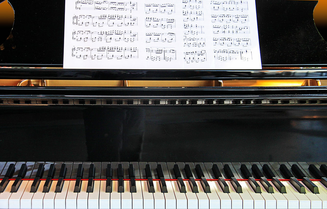 music, musical instrument, piano, piano key, arts culture and entertainment, keyboard instrument, musical equipment, sheet music, playing, musical note, indoors, classical music, synthesizer, pianist, close-up, performance, skill, musician, musical instrument string, keyboard, day