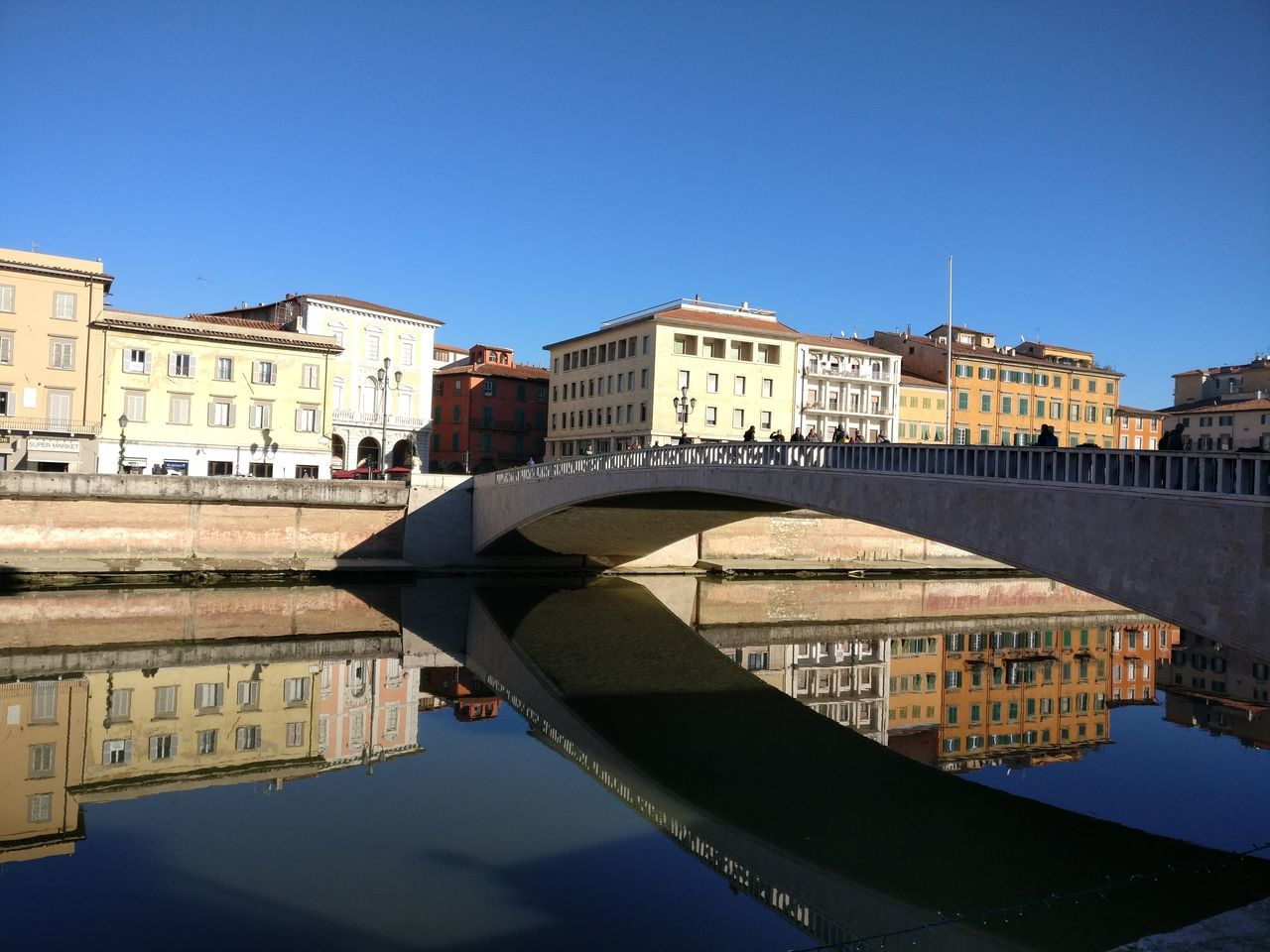 Reflection Water Building Exterior Clear Sky Built Structure City Waterfront Architecture Outdoors Bridge - Man Made Structure No People Sky Day Sunlight Color Cloud - Sky UpsideDownShot Upside Down Photography Riverscape River View Arno River Pisa Pisa - Italy Human Eye Landscape