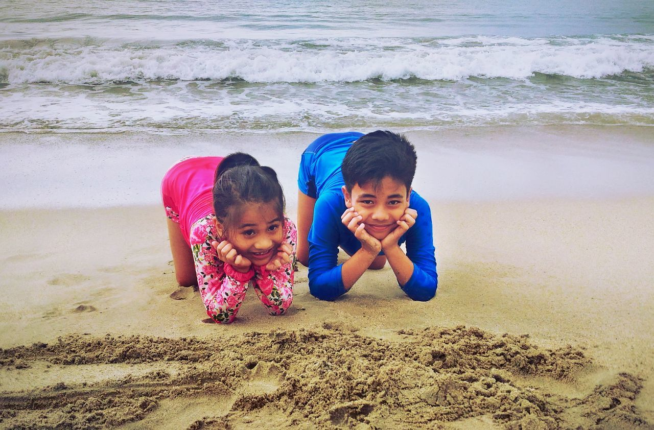 Kids at the Beach. Child Togetherness Happiness Childhood Family Sibling Leisure Activity Cheerful Fun Friendship Outdoors Smiling Beach Playing Attemptsatphotography Day Family Asuszenfone2 Two People Males  Females Brother Lifestyles Offspring
