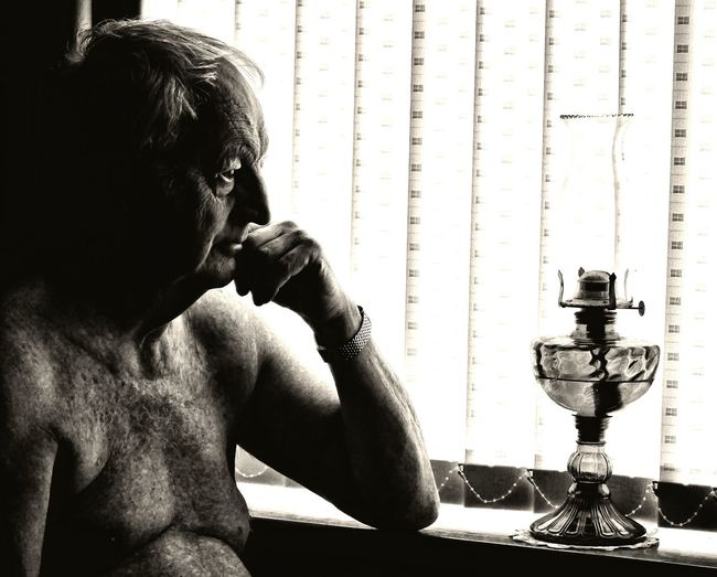 Thoughtful senior Real People Home Interior Shirtless Man Mature Face Portrait Pensioner Wise Old Owl Thoughtful Contemplative Monochrome Time To Reflect Senior Adult