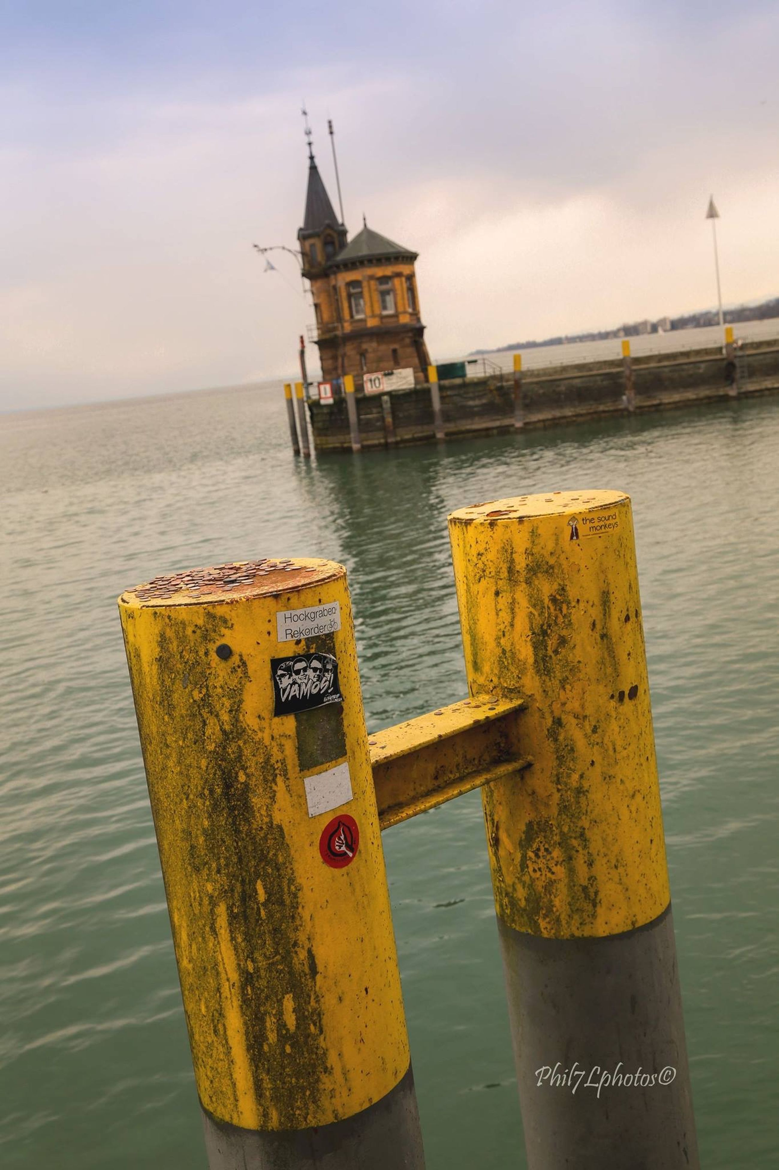 water, sea, sky, yellow, horizon over water, cloud - sky, tranquility, tranquil scene, scenics, nature, guidance, wooden post, pier, text, waterfront, beauty in nature, built structure, outdoors, no people, nautical vessel