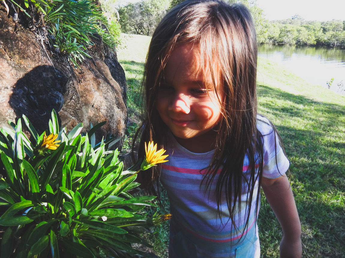 Child Childhood Curiosity Cute Day Family Flower Flowers Girls Happiness Leisure Activity Nature One Girl Only One Person Outdoors People Plant Real People Smelling The Flowers Smiling The Portraitist - 2017 EyeEm Awards Live For The Story