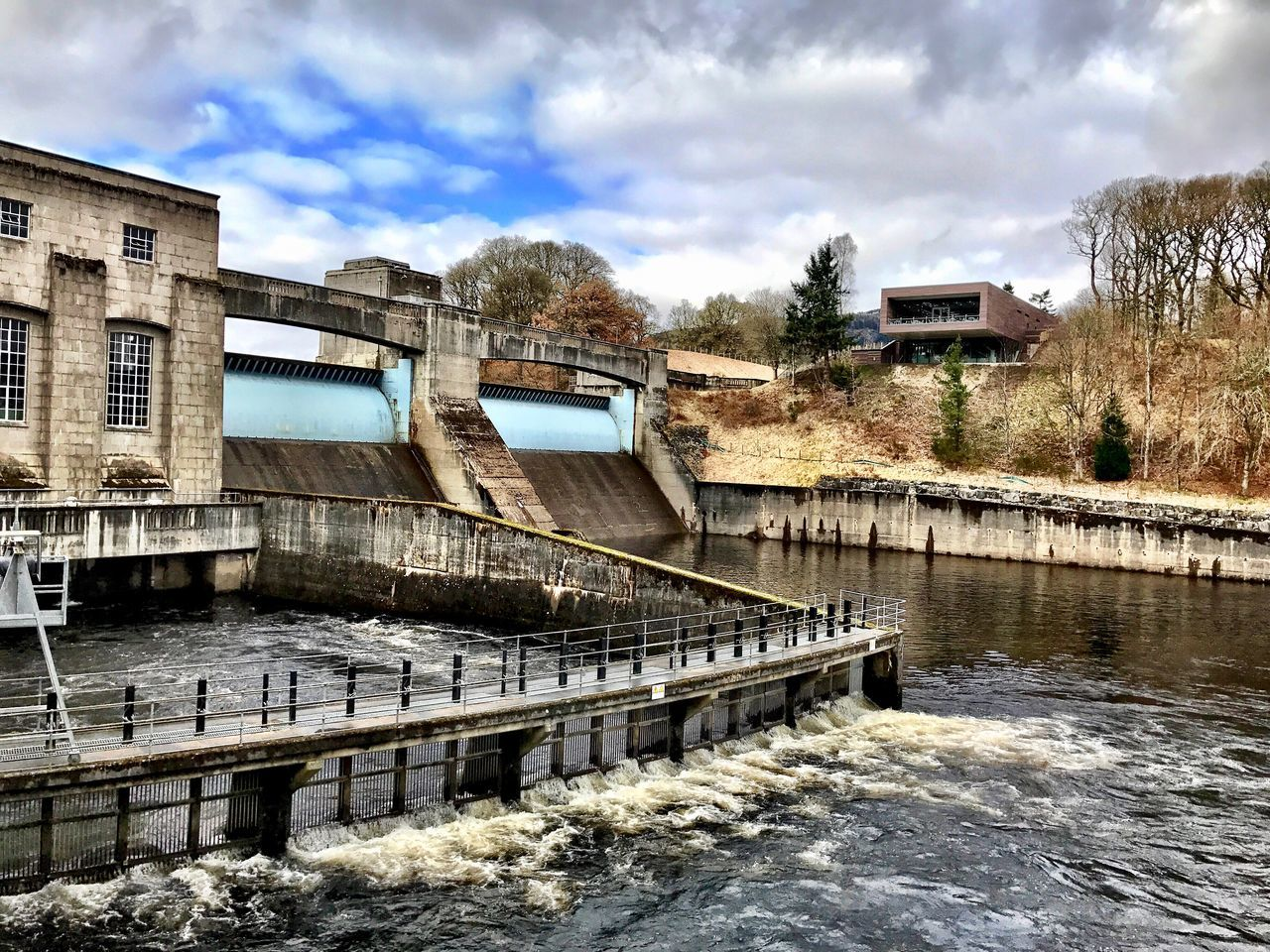 Pitlochry Dam & Visitor Centre Architecture Built Structure Water Cloud - Sky Dam Building Exterior Sky Hydroelectric Power Bridge - Man Made Structure Day Connection River Outdoors No People Tree Nature Power In Nature