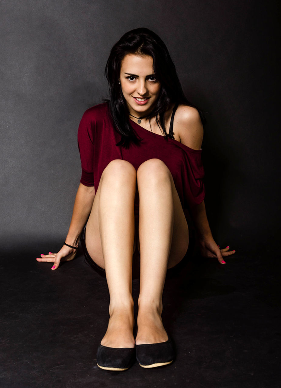 young adult, one person, young women, full length, real people, beautiful woman, looking at camera, sitting, portrait, lifestyles, front view, studio shot, high heels, beauty, fashion model, indoors, day, adult, people