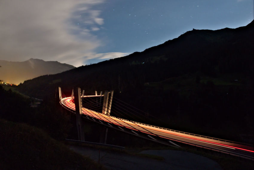 Brigding the darkness Architecture Bridge Cloud - Sky Dark Darkness And Light Davos Illuminated Klosters Landscape Light Trail Long Exposure Mountain Night Nightphotography No People Prättigau Road Serneus Sky Sunniberg Bridge Eyeemphoto