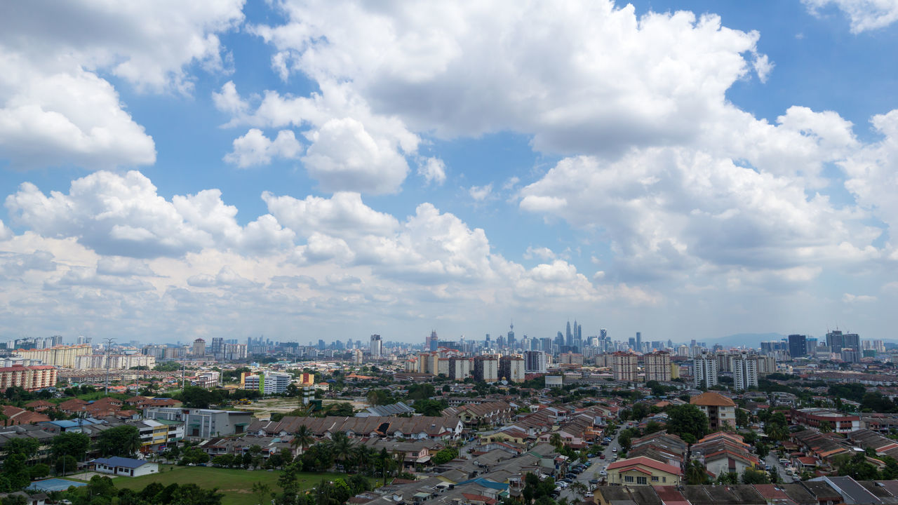 Blue sky with clouds in downtown Kuala Lumpur, Malaysia Bright Daylight Business Finance And Industry Cityscape Photography Development Housing Settlement Kuala Lumpur Malaysia  Moving Clouds Petronas Twin Towers Skyline
