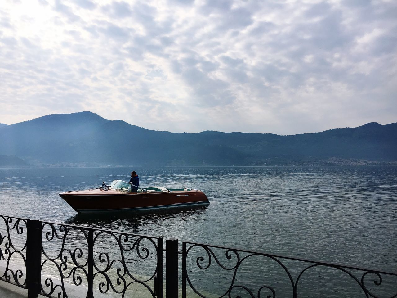 Arriva. Water Mountain Sky Cloud - Sky Tranquility Scenics Beauty In Nature Nature One Person Outdoors Sea Real People Men Mountain Range Day Nautical Vessel People Boat Speedboat Riva  Old Boat Lake