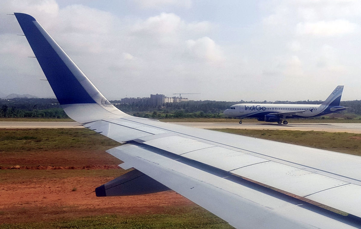 Airplane Airport Aircraft Wing Airport Runway Transportation Commercial Airplane No People Day Outdoors Indigo Airlines