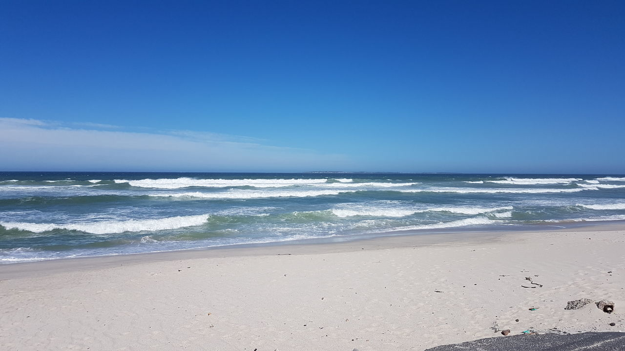 Sea Beach Sand Horizon Over Water Water Wave Surf Blue Sky Scenics Nature Tide Beauty In Nature Outdoors Coastal Feature Day No People Vacations South Africa 🇿🇦 Western Cape Cape Town