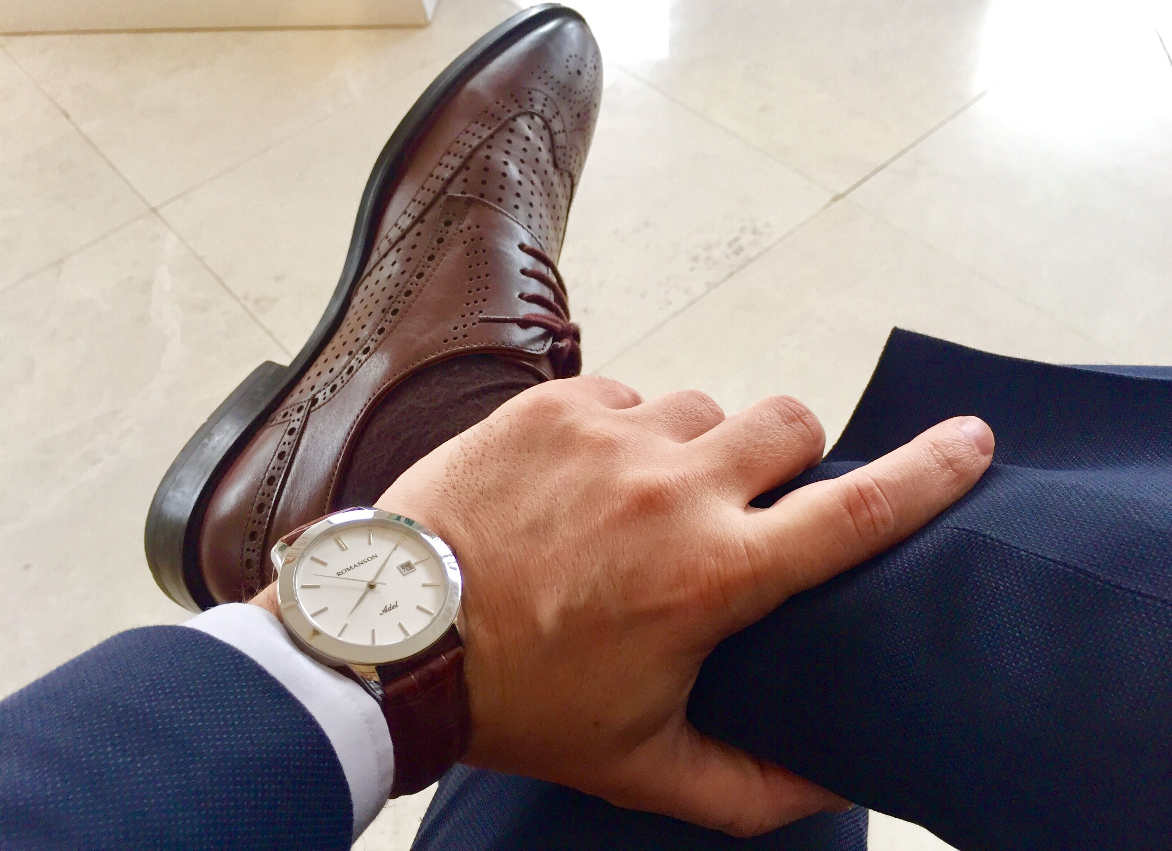 low section, human leg, high angle view, one person, close-up, real people, human body part, shoe, leisure activity, one man only, clock, time, adults only, adult, day, people, only men