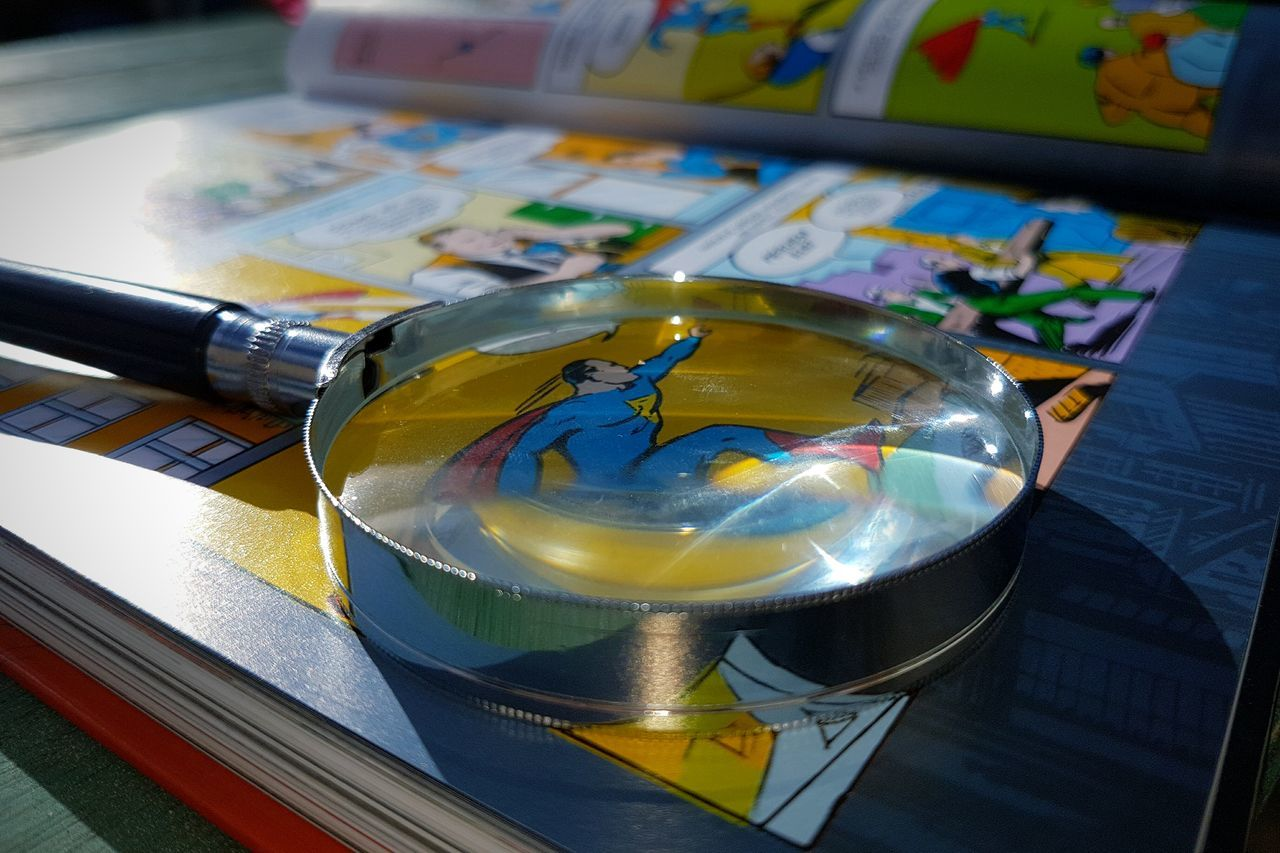 Comics Comic Books Comic Con Superheroes HQs Magnifying Glass Close-up Colors Palette Reading A Book Reading Time Reading Glasses Premium Collection Getty Images Bestsellers EyeEmNewHere Reading Heroes EyeEm Selects