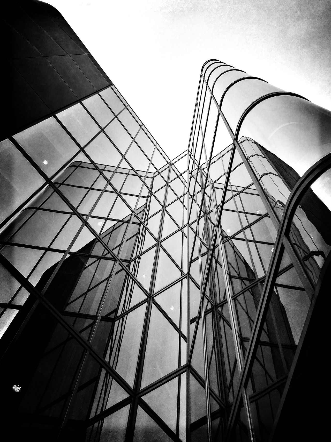 Architecture Bnw Bnw_captures Bnw_collection Building Exterior Built Structure Connection Day Glass Glass Building Lines Lines And Shapes Lookingup Lookup Low Angle View No People Office Building Office Building Exterior Outdoors Reflection Reflections Shapes Shapes And Forms Sky Windows