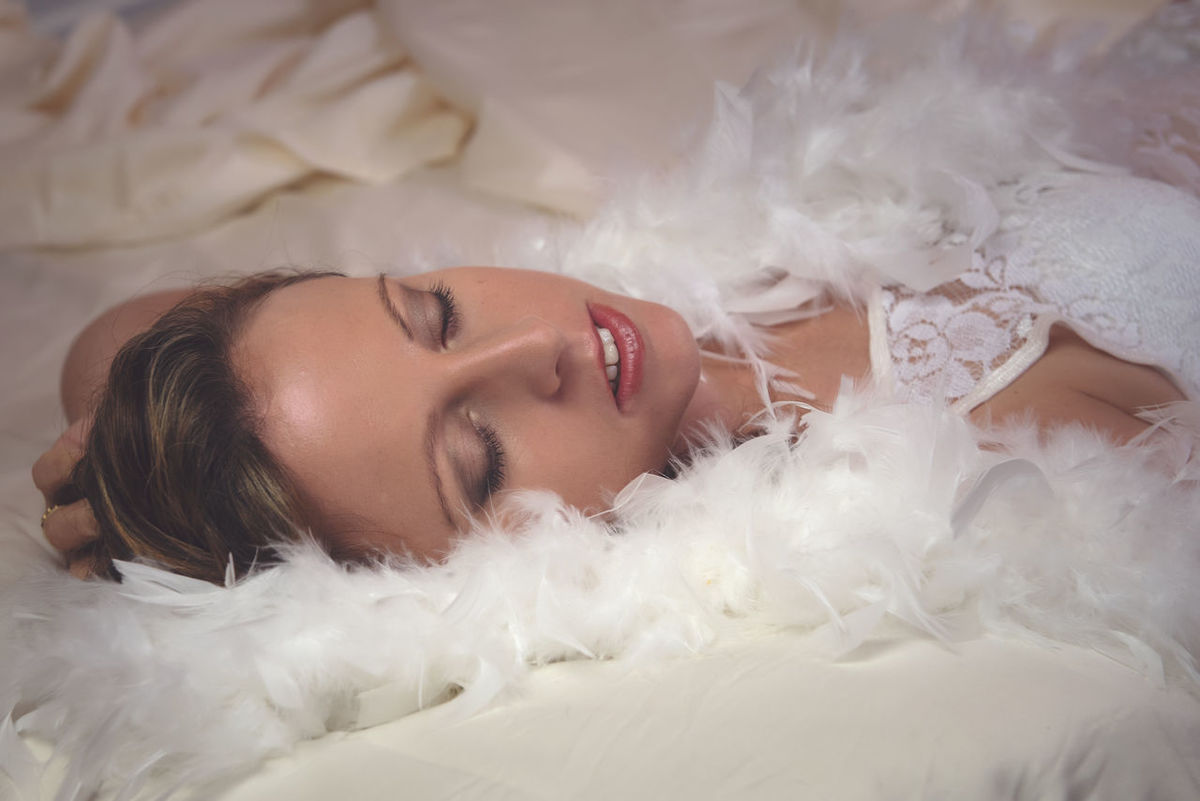 Feather Boa Beauty Boudoir Boudoir Photography Boudoirphotoshoot Close-up Cute Featherboa Feathers Headshot Human Face Leisure Activity Lifestyles Lying Down Portrait Relaxation Resting White Woman