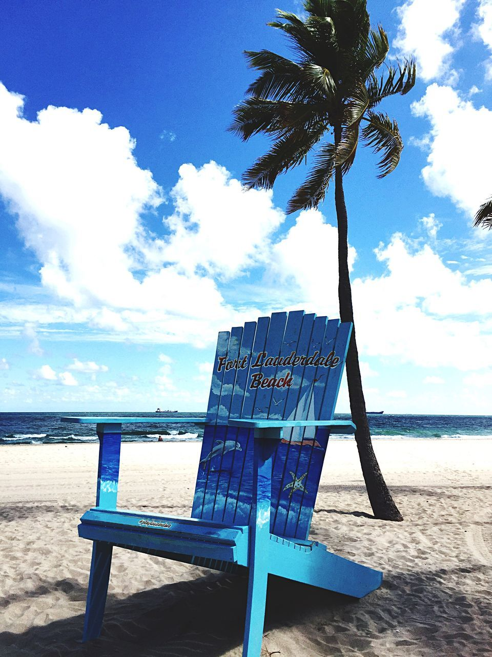 beach, sea, sky, water, horizon over water, nature, sand, scenics, tranquility, tranquil scene, shore, chair, cloud - sky, beauty in nature, day, outdoors, relaxation, no people, vacations, blue