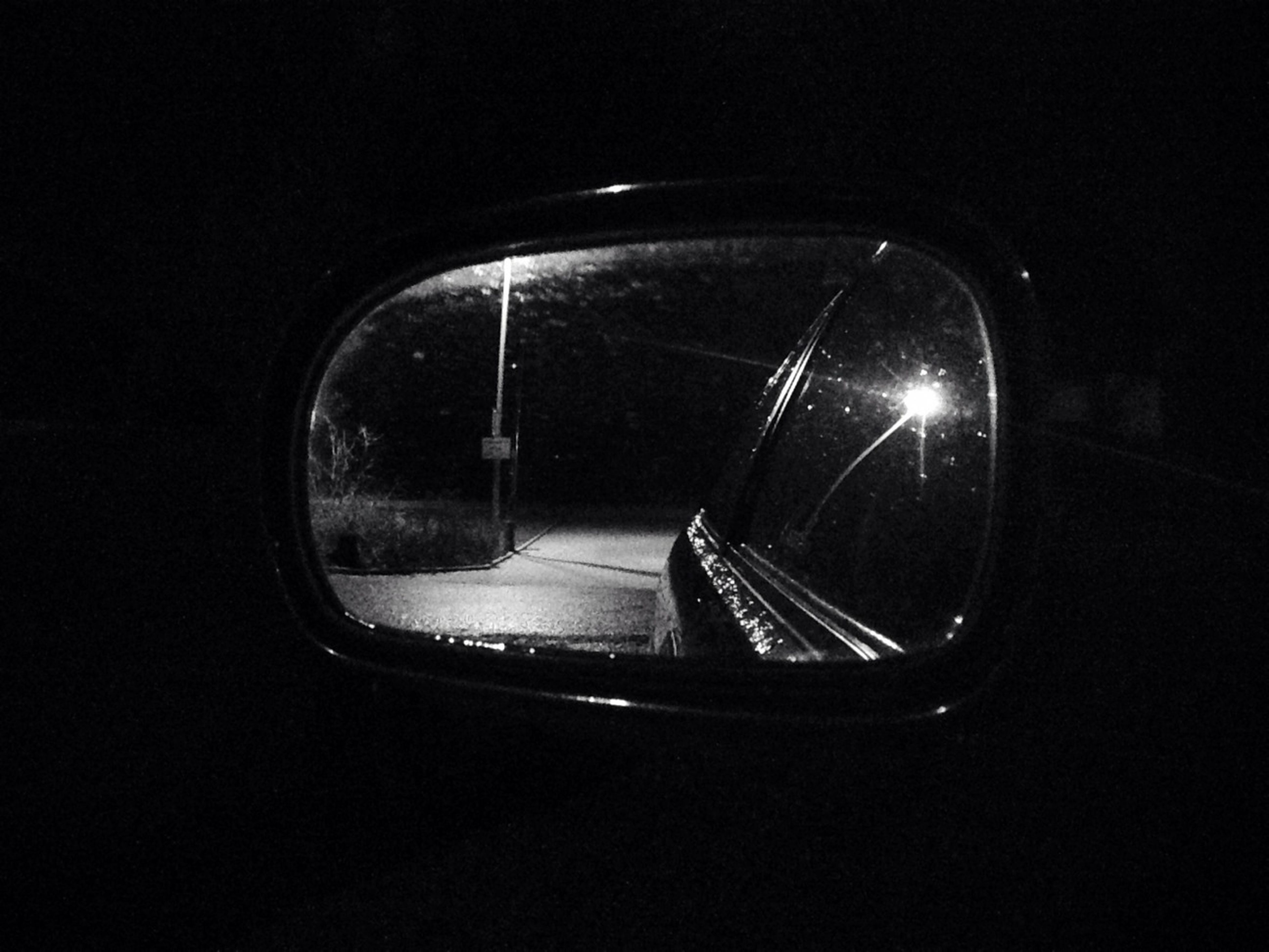 transportation, mode of transport, car, land vehicle, glass - material, transparent, reflection, window, vehicle interior, road, side-view mirror, on the move, street, travel, motion, indoors, windshield, car interior, night, close-up