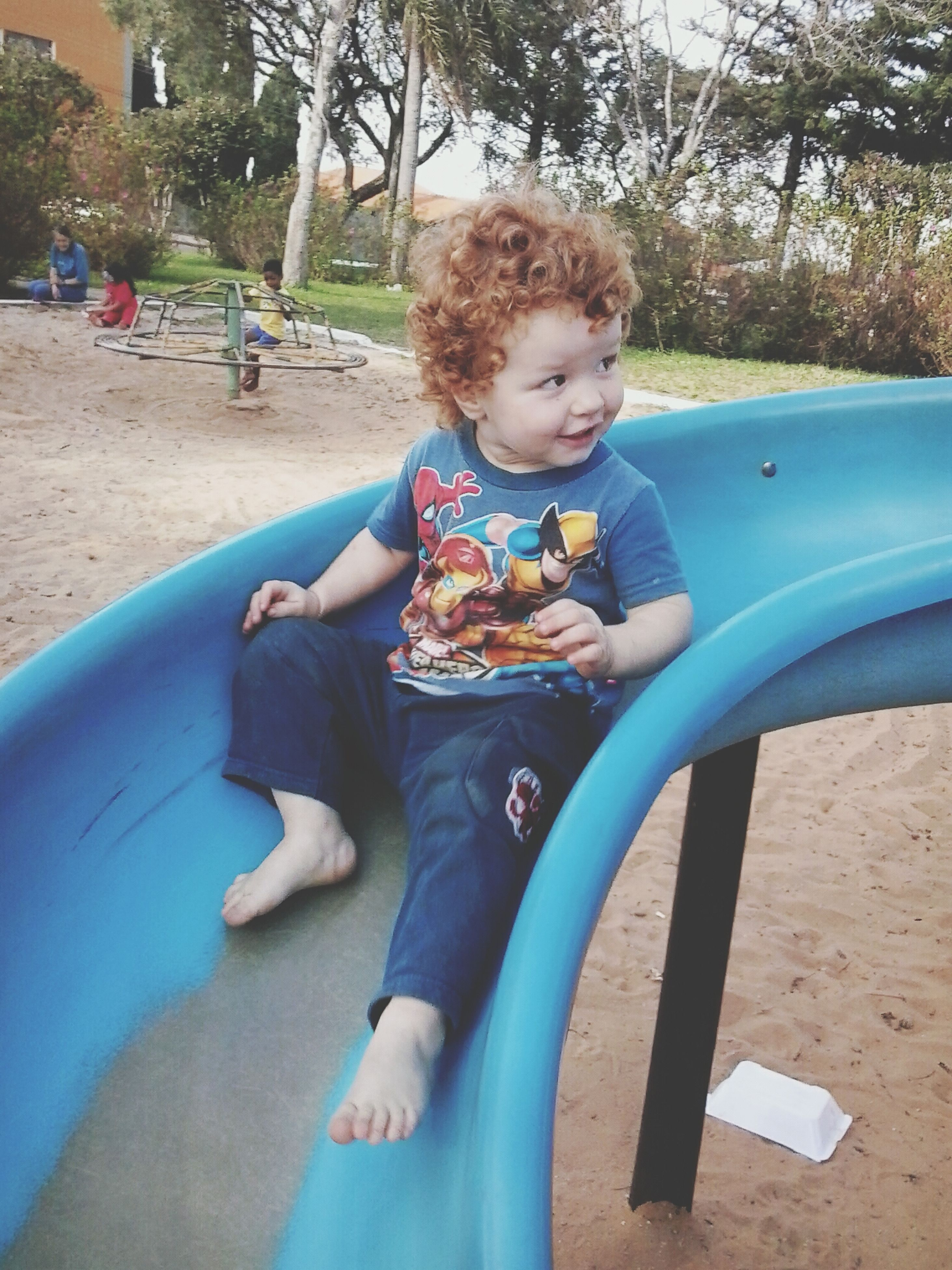 childhood, elementary age, leisure activity, lifestyles, person, boys, park - man made space, sitting, innocence, playground, girls, cute, relaxation, tree, casual clothing, full length, playing, fun