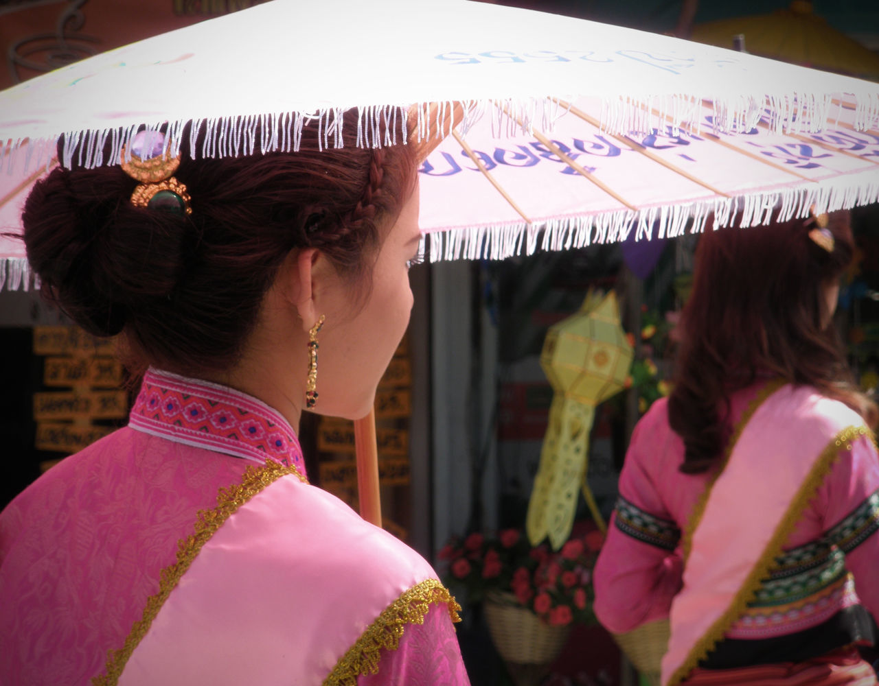 Beauty Beauty Contest Colour Colourful Focus On Foreground Head And Shoulders Incidental People Rear View Spotted In Thailand Standing Thai Thailand Umbrella Waist Up Young Women Telling Stories Differently