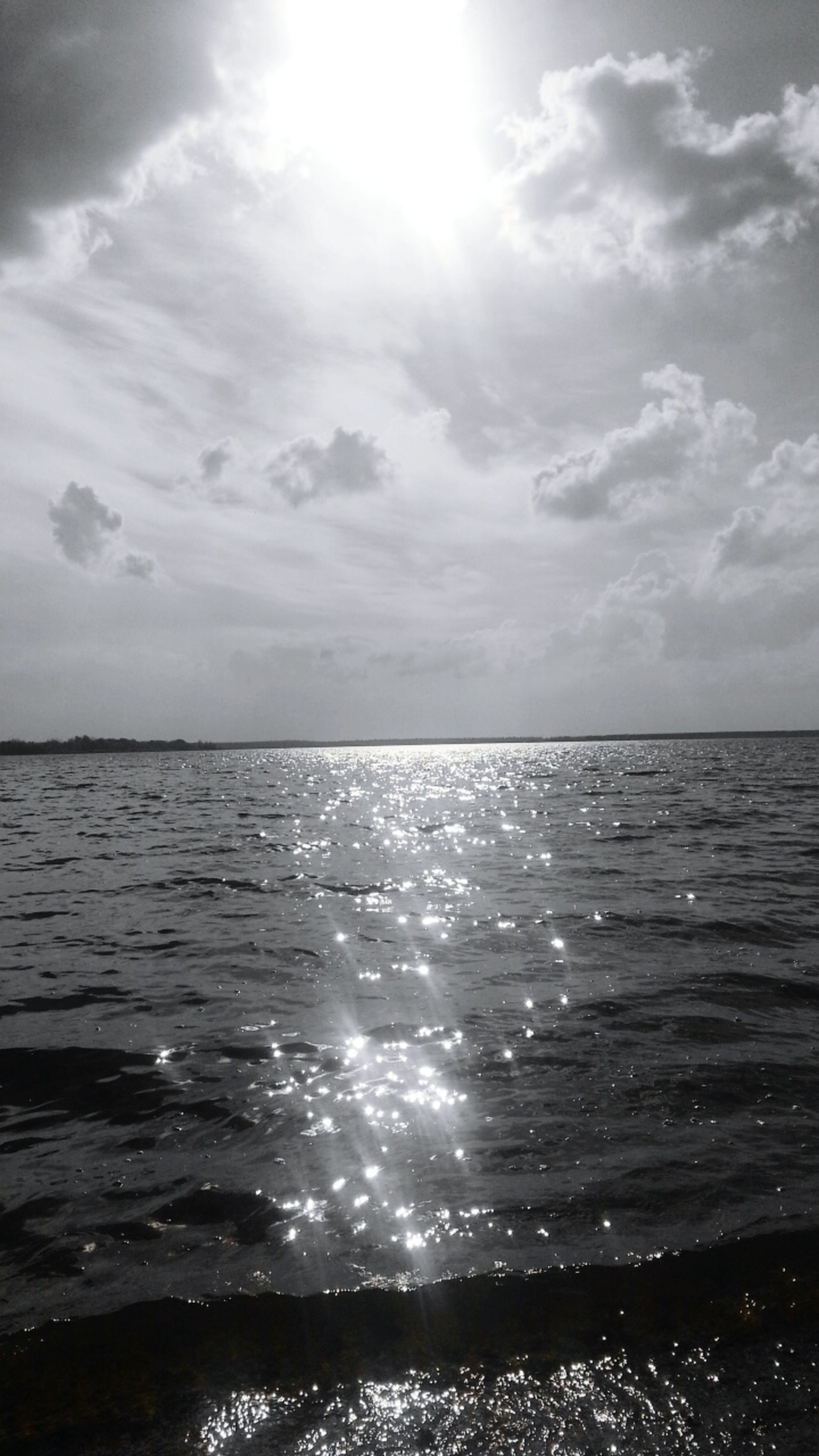 sea, water, horizon over water, sky, tranquil scene, scenics, tranquility, beauty in nature, sun, nature, cloud - sky, beach, waterfront, reflection, sunlight, idyllic, seascape, rippled, cloud, sunbeam