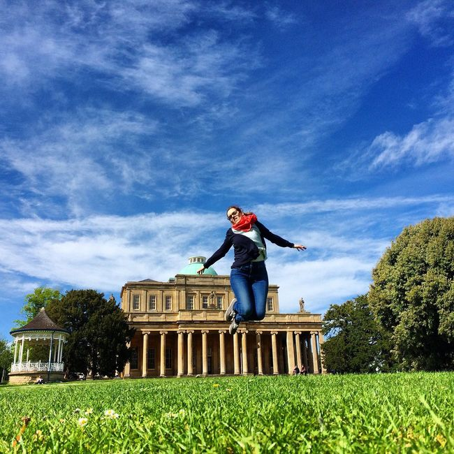 Pittville Park Garden Outdoor Grass Building Woman Jumping Cheltenham England